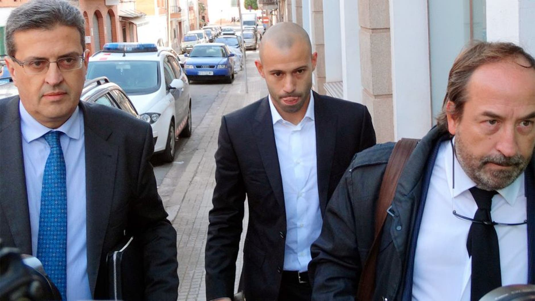 BARCELONA, SPAIN - OCTOBER 29: Barcelona football player Javier Mascherano (C) attends court charged of defrauding more than 1,5 million euros on October 29, 2015 in Barcelona, Spain. (Photo by Europa Press/Europa Press via Getty Images)