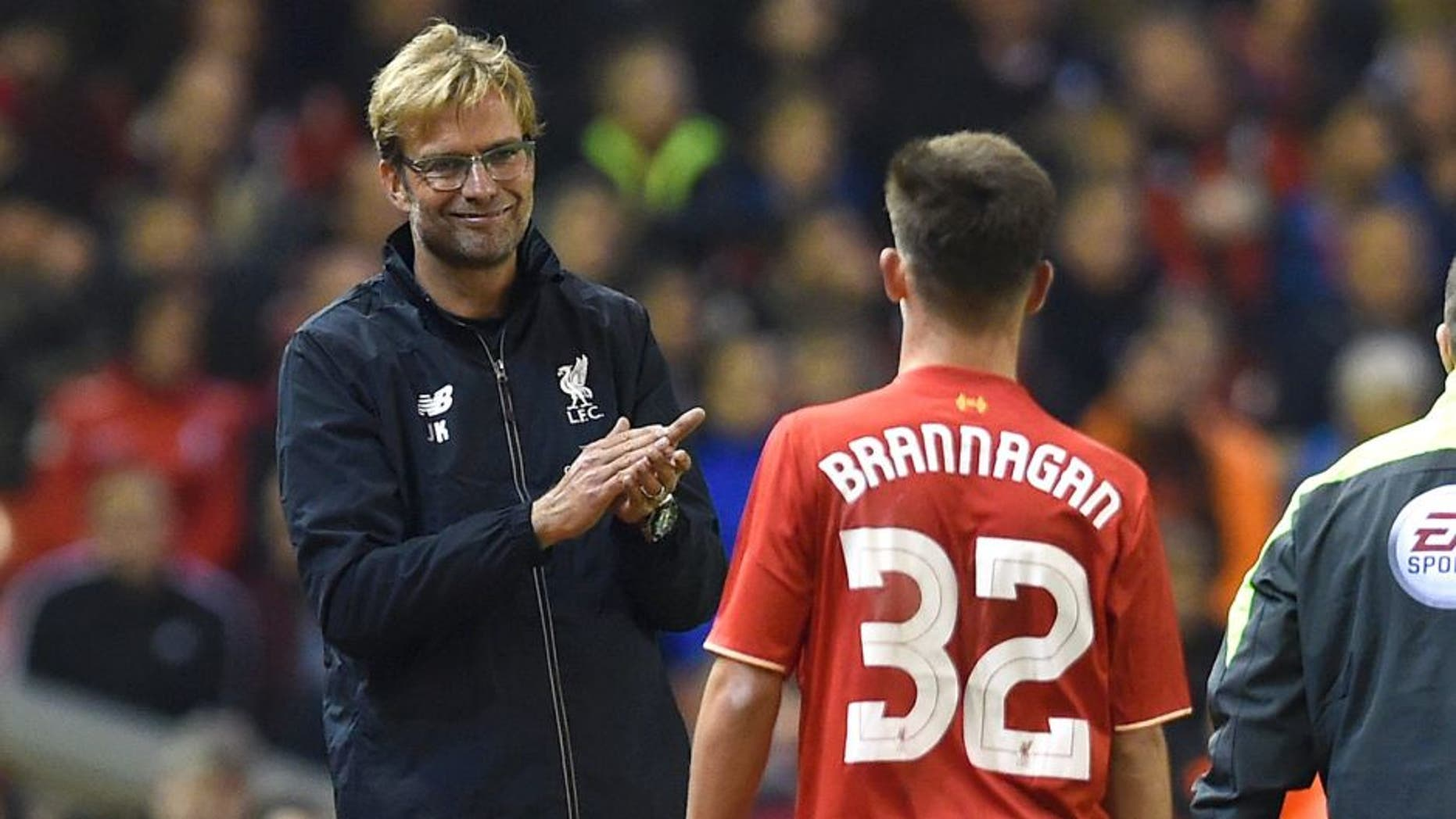 LIVERPOOL, ENGLAND - OCTOBER 28: (THE SUN OUT, THE SUN ON SUNDAY OUT) Jurgen Klopp manager of Liverpool gives a hug and a clap to Cameron Brannagan of Liverpool during the Capital One Cup Fourth Round match between Liverpool and AFC Bournemouth at Anfield on October 28, 2015 in Liverpool, England. (Photo by John Powell/Liverpool FC via Getty Images)