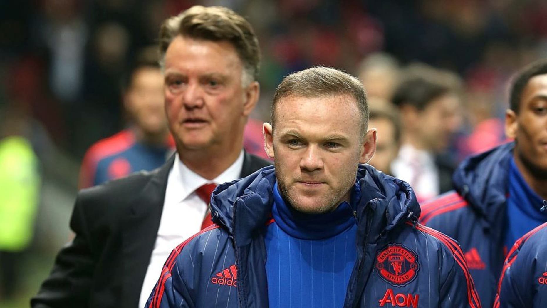 MANCHESTER, ENGLAND - OCTOBER 28: Manager Louis van Gaal and Wayne Rooney of Manchester United walk to the bench ahead of the Capital One Fourth Round match between Manchester United and Middlesbrough at Old Trafford on October 28, 2015 in Manchester, England. (Photo by Matthew Peters/Man Utd via Getty Images)