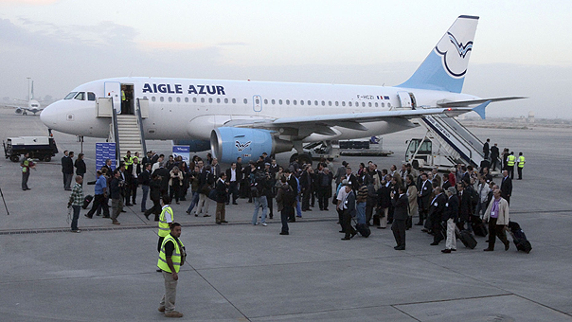 Oct. 31: A group of French business leaders leaves the Aigle Azur plane after arriving in Baghdad, Iraq.