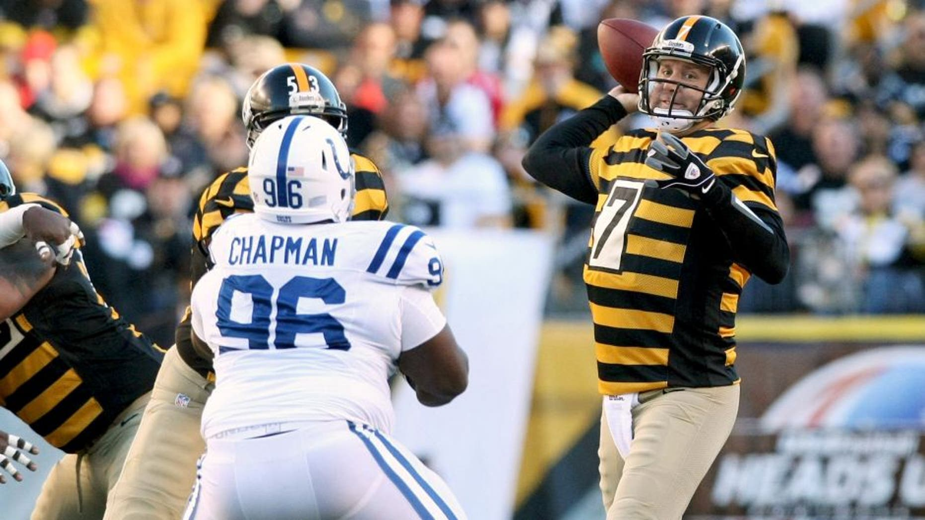 Oct 26, 2014; Pittsburgh, PA, USA; Pittsburgh Steelers quarterback Ben Roethlisberger (7) throws a pass under pressure from Indianapolis Colts nose tackle Josh Chapman (96) during the first quarter of their game at Heinz Field. Mandatory Credit: Jason Bridge-USA TODAY Sports
