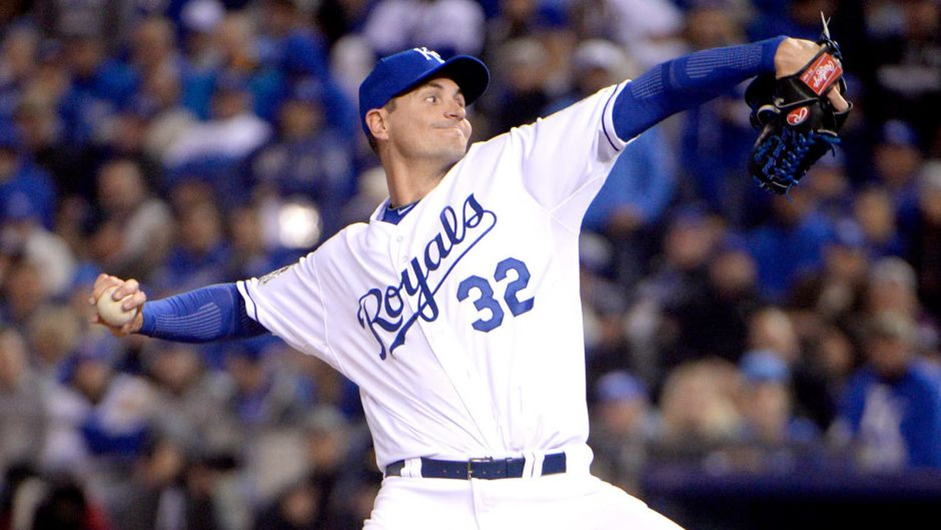 Oct 27, 2015; Kansas City, MO, USA; Kansas City Royals pitcher Chris Young (32) throws a pitch against the New York Mets in the 12th inning in game one of the 2015 World Series at Kauffman Stadium. Mandatory Credit: John Rieger-USA TODAY Sports
