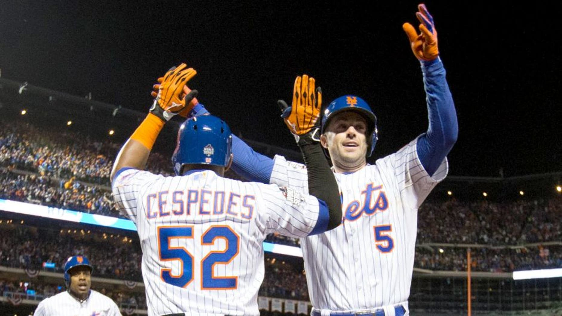 NEW YORK, NY - OCTOBER 30: David Wright #5 of the New York Mets is greeted by teammate Yoenis Cespedes after hitting a two-run home run in the bottom of the first inning of Game 3 of the 2015 World Series against the Kansas City Royals at Citi Field on Friday, October 30, 2015 in the Queens borough of New York City. (Photo by Rob Tringali/MLB Photos via Getty Images)