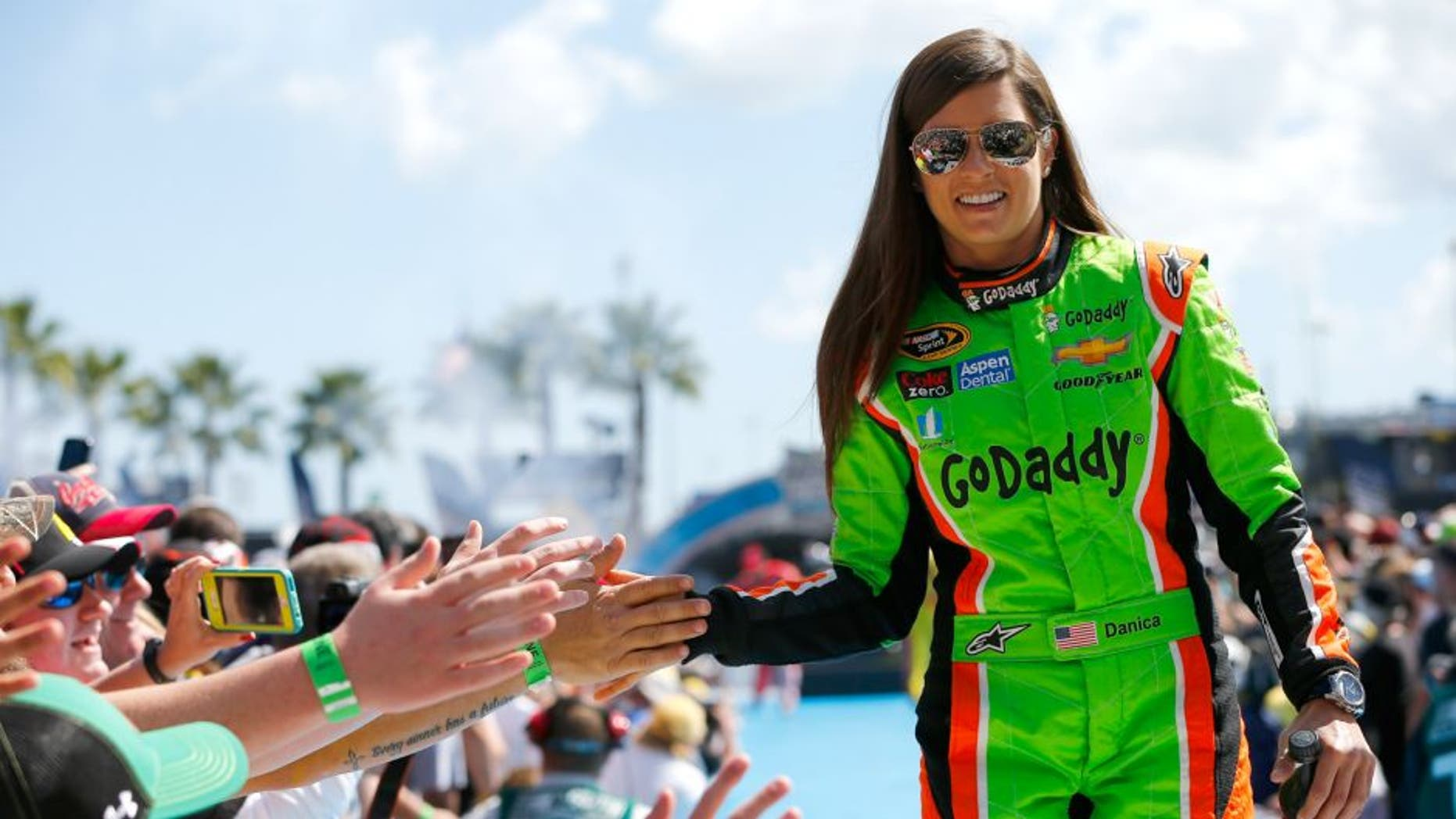 Danica Patrick, driver of the #10 GoDaddy Chevrolet, greets fans during the NASCAR Sprint Cup Series 57th Annual Daytona 500 at Daytona International Speedway on February 22, 2015 in Daytona Beach, Florida.