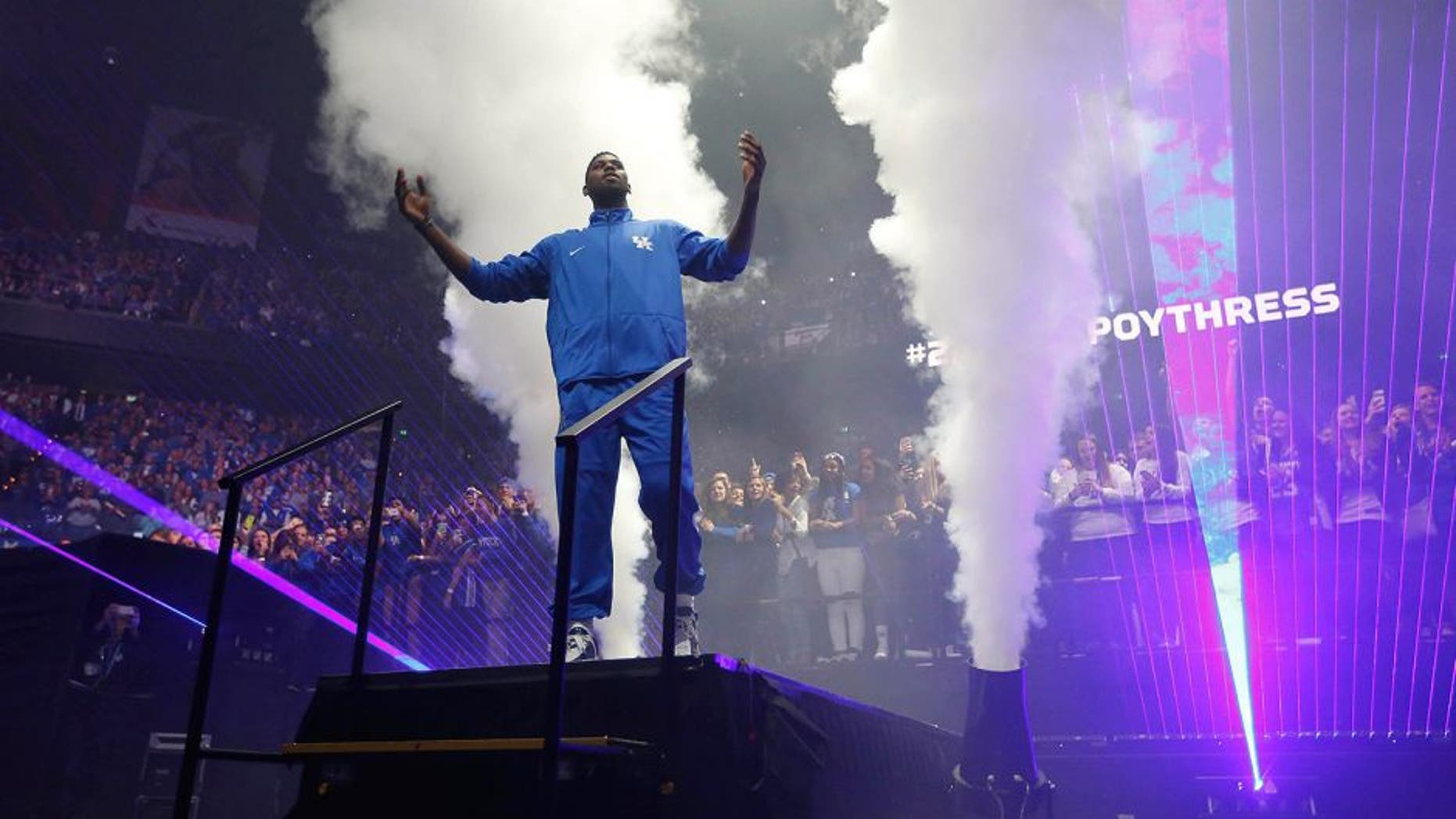 Oct 16, 2015; Lexington, KY, USA; Kentucky Wildcats forward Alex Poythress (22) waves to the crowd during player introduced prior to the Kentucky Blue Madness at Rupp Arena. Mandatory Credit: Mark Zerof-USA TODAY Sports