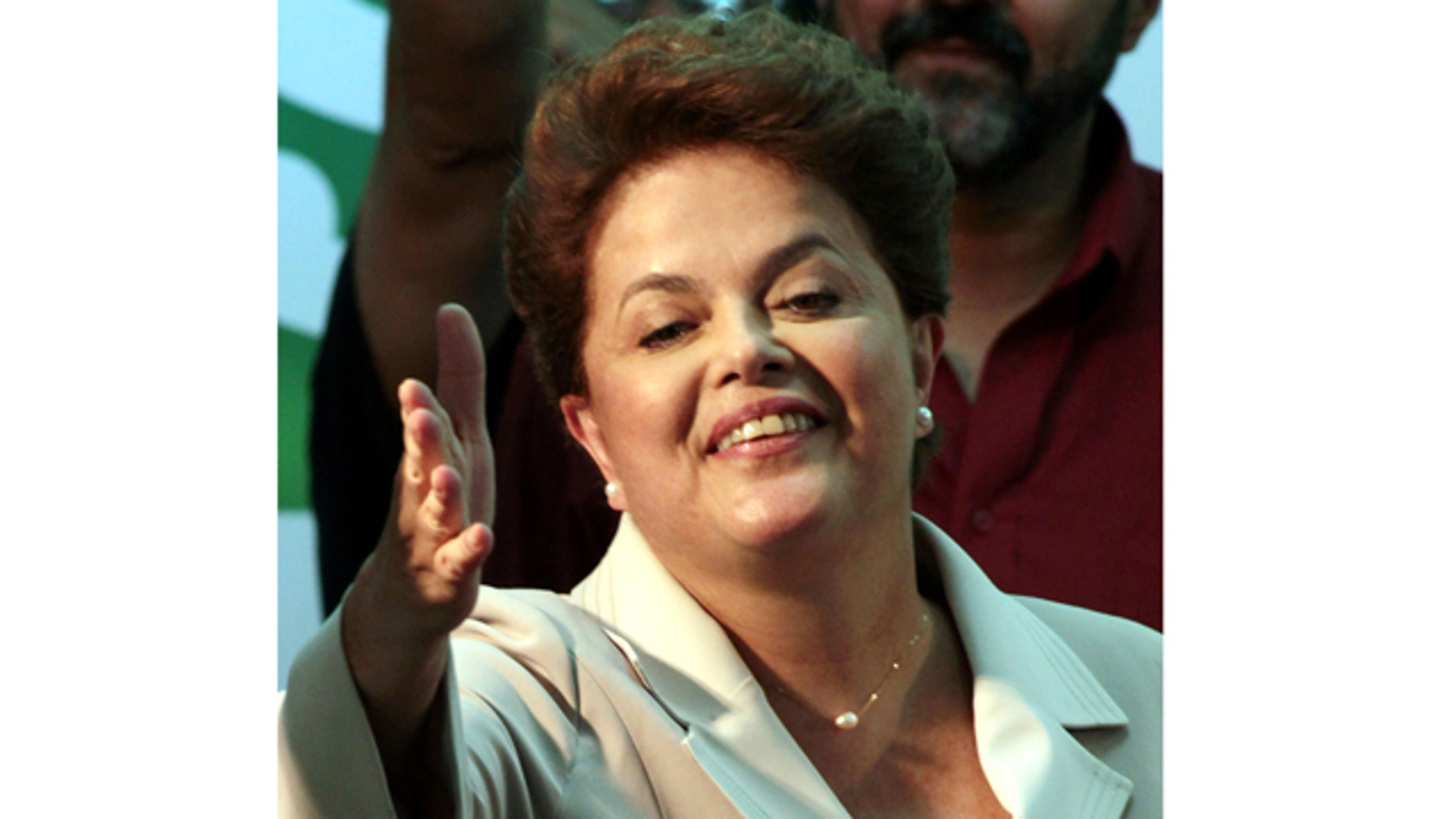 Oct. 31: Brazil's President-elect Dilma Rousseff, of the Workers Party, gestures to supporters as she arrives to give her victory speech after winning the election runoff in Brasilia, Brazil.