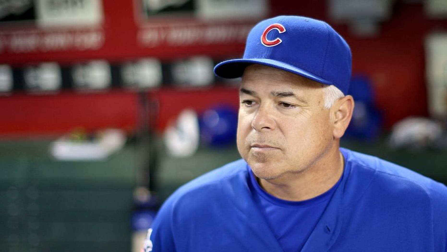 PHOENIX, AZ - JULY 18: Manager Rick Renteria #16 of the Chicago Cubs watches from the dugout during the MLB game against the Arizona Diamondbacks at Chase Field on July 18, 2014 in Phoenix, Arizona. (Photo by Christian Petersen/Getty Images) *** Local Caption *** Rick Renteria