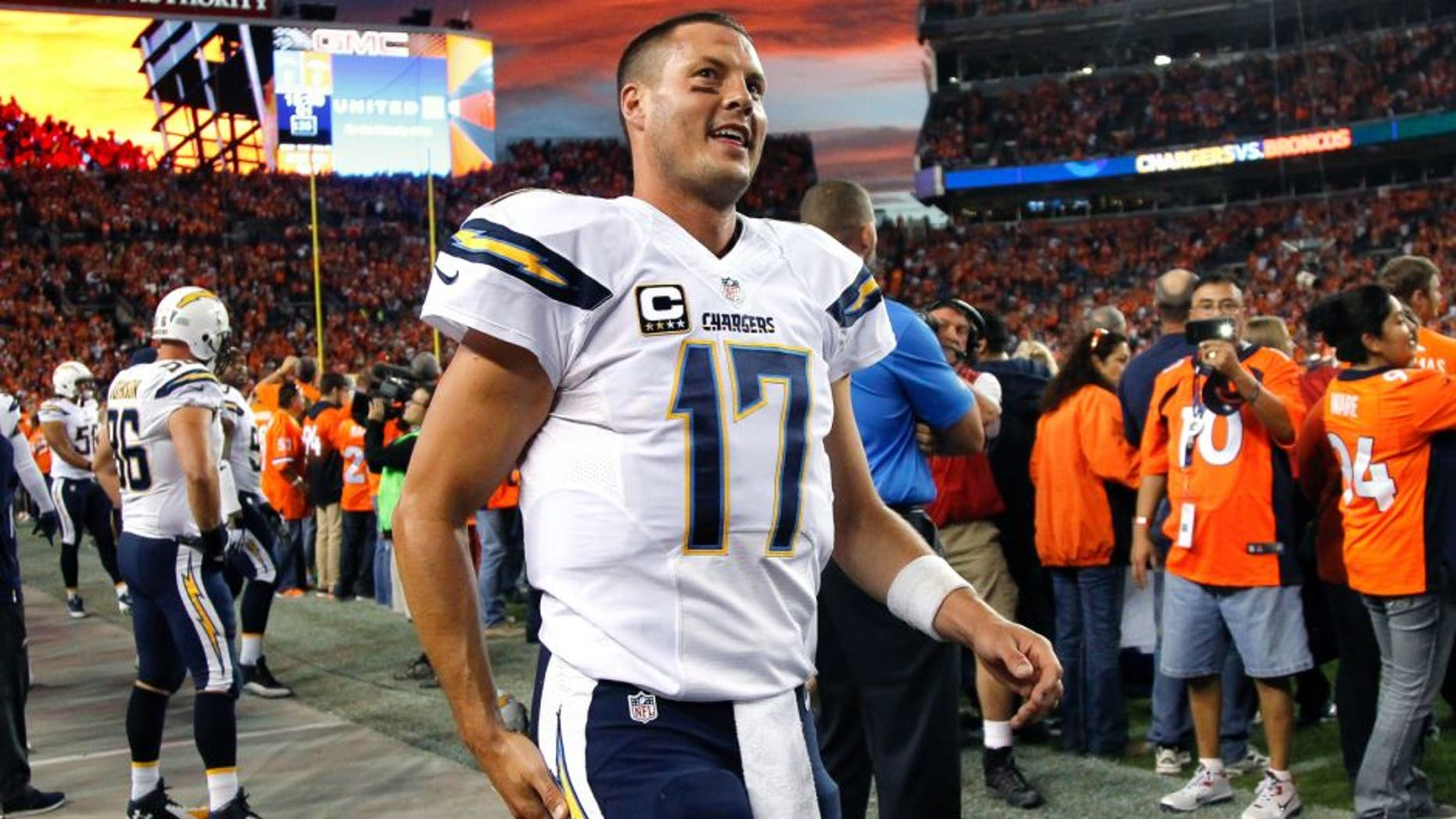 DENVER, CO - OCTOBER 23: Quarterback Philip Rivers #17 of the San Diego Chargers jogs along the sideline before the start of a game against the Denver Broncos at Sports Authority Field at Mile High on October 23, 2014 in Denver, Colorado. (Photo by Doug Pensinger/Getty Images)