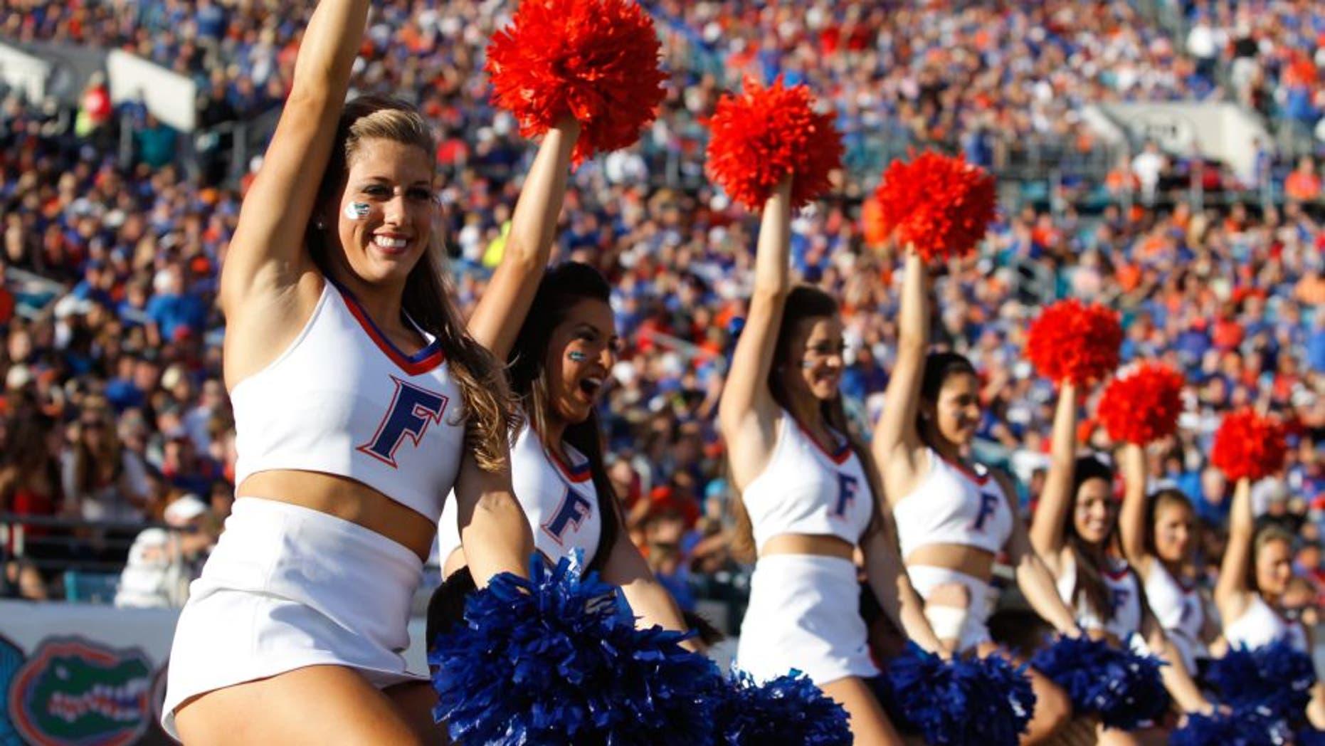 Nov 2, 2013; Jacksonville, FL, USA; Florida Gators cheerleaders cheer against the Georgia Bulldogs during the second quarter at EverBank Field. Mandatory Credit: Kim Klement-USA TODAY Sports