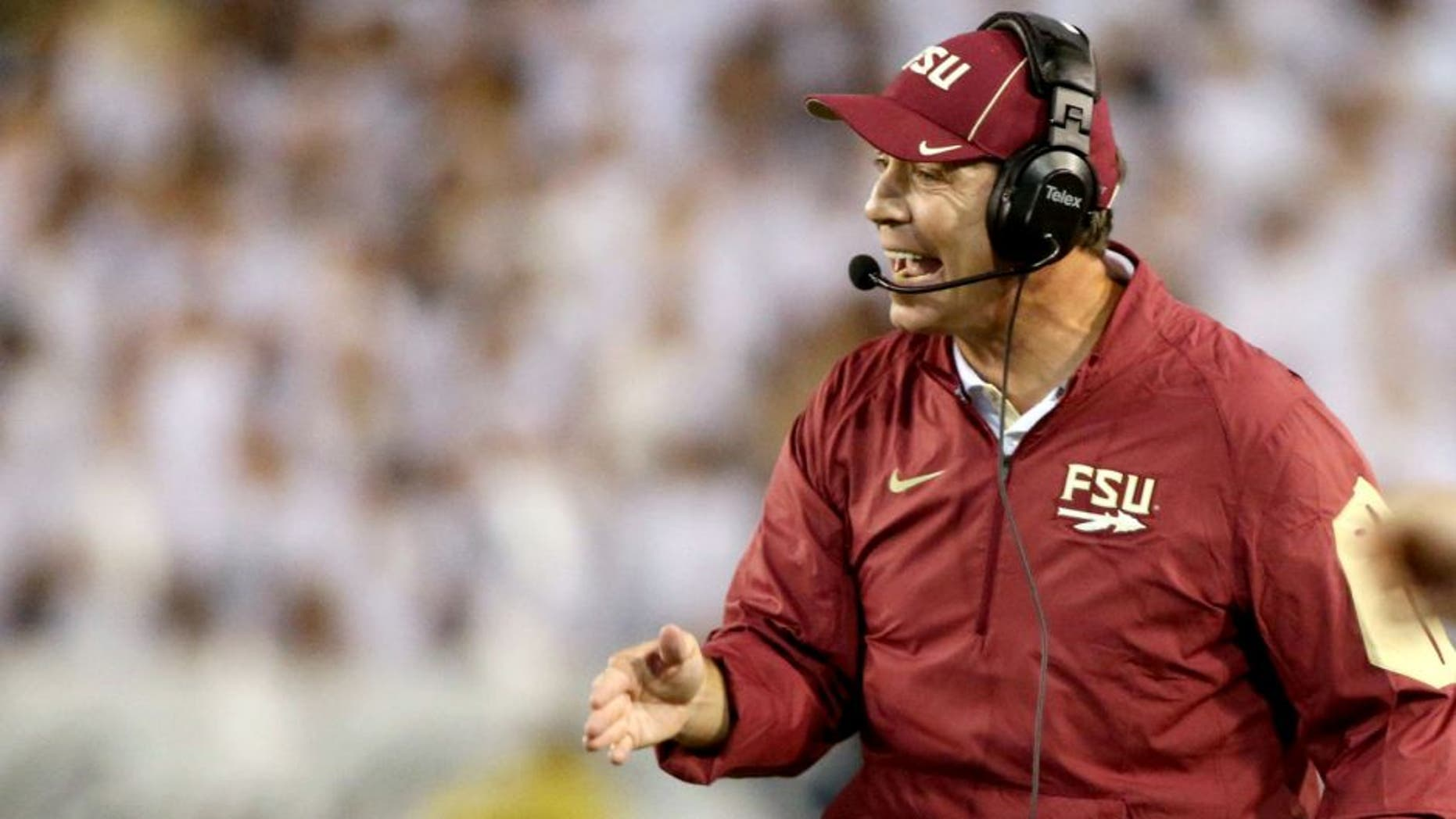 Oct 24, 2015; Atlanta, GA, USA; Florida State Seminoles head coach Jimbo Fisher argues a call with an official during the fourth quarter of their game against the Georgia Tech Yellow Jackets at Bobby Dodd Stadium. Georgia Tech won 22-16. Mandatory Credit: Jason Getz-USA TODAY Sports