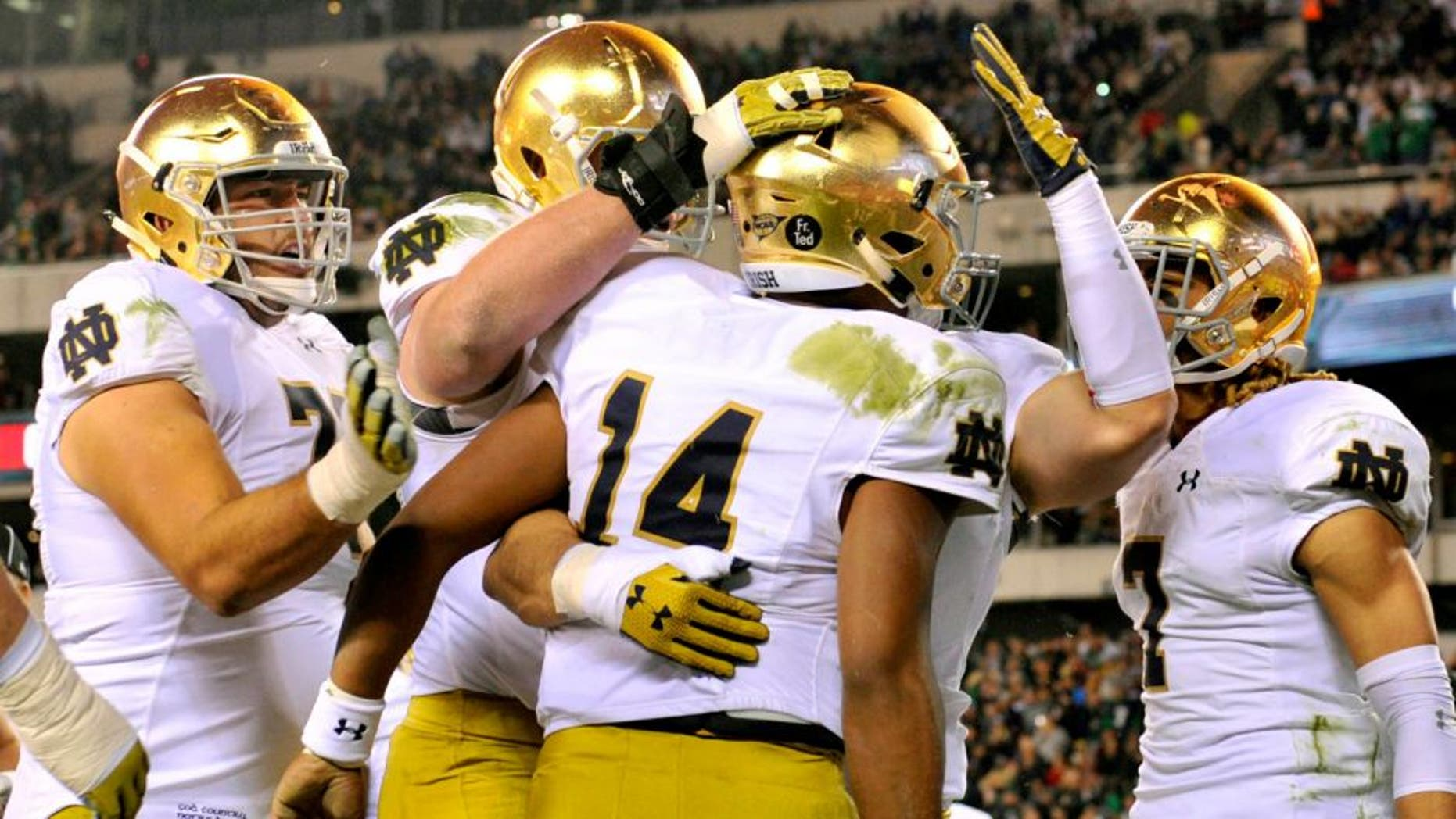 Oct 31, 2015; Philadelphia, PA, USA; Notre Dame Fighting Irish quarterback DeShone Kizer (14) celebrates with teammates after a touchdown against the Temple Owls during the first quarter at Lincoln Financial Field. Mandatory Credit: Derik Hamilton-USA TODAY Sports