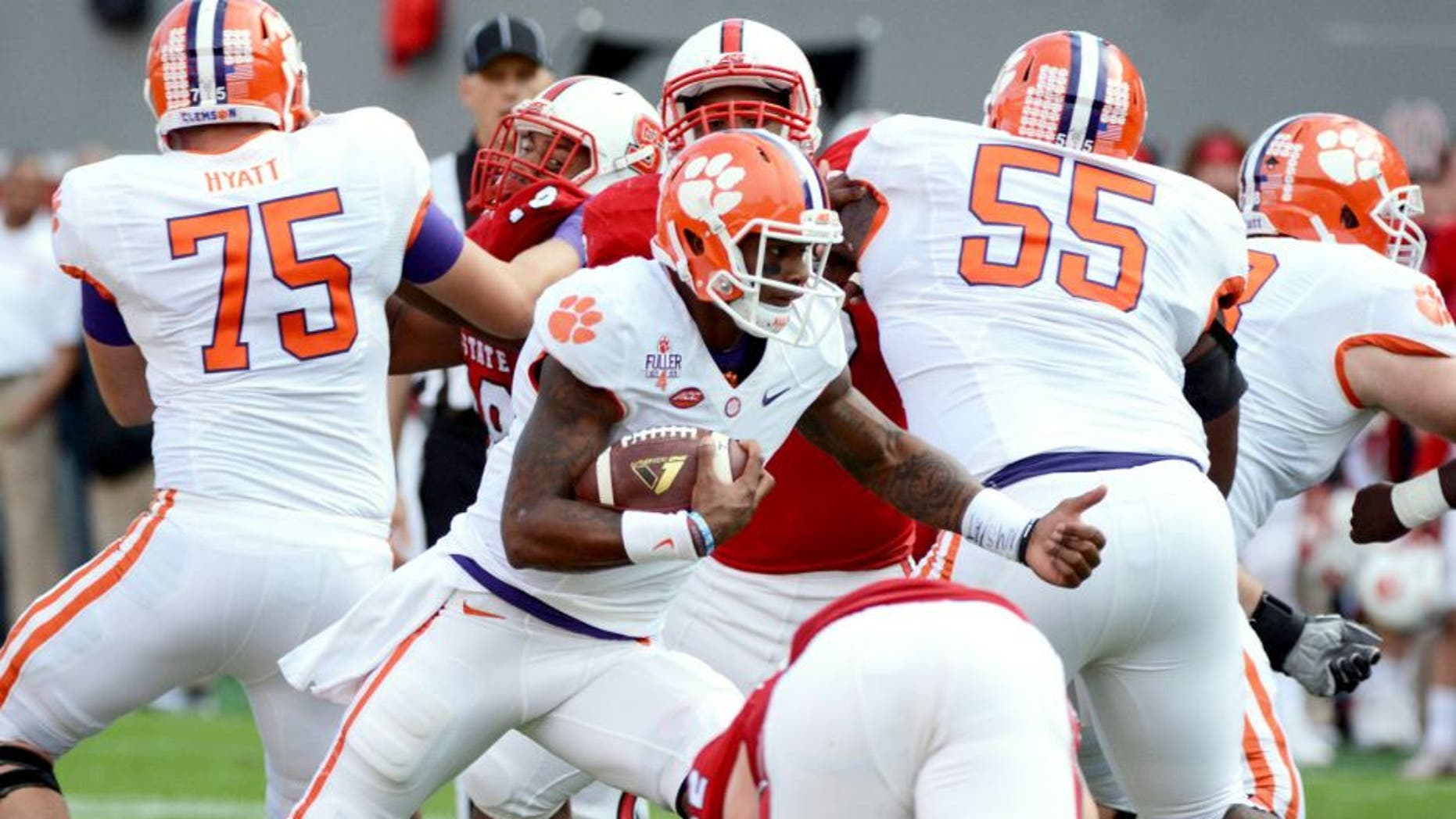 Oct 31, 2015; Raleigh, NC, USA; Clemson Tigers quarterback Deshaun Watson (4) runs the ball during the first half against the North Carolina State Wolfpack at Carter Finley Stadium. Mandatory Credit: Rob Kinnan-USA TODAY Sports