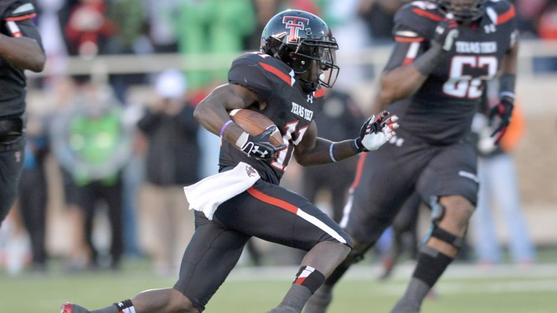 LUBBOCK, TX - NOVEMBER 2: Jakeem Grant #11 of the Texas Tech Red Raiders rushes the ball during game action against the Oklahoma State Cowboys on November 2, 2013 at AT&T Jones Stadium in Lubbock, Texas. Oklahoma State won the game 52-34 (Photo by John Weast/Getty Images)