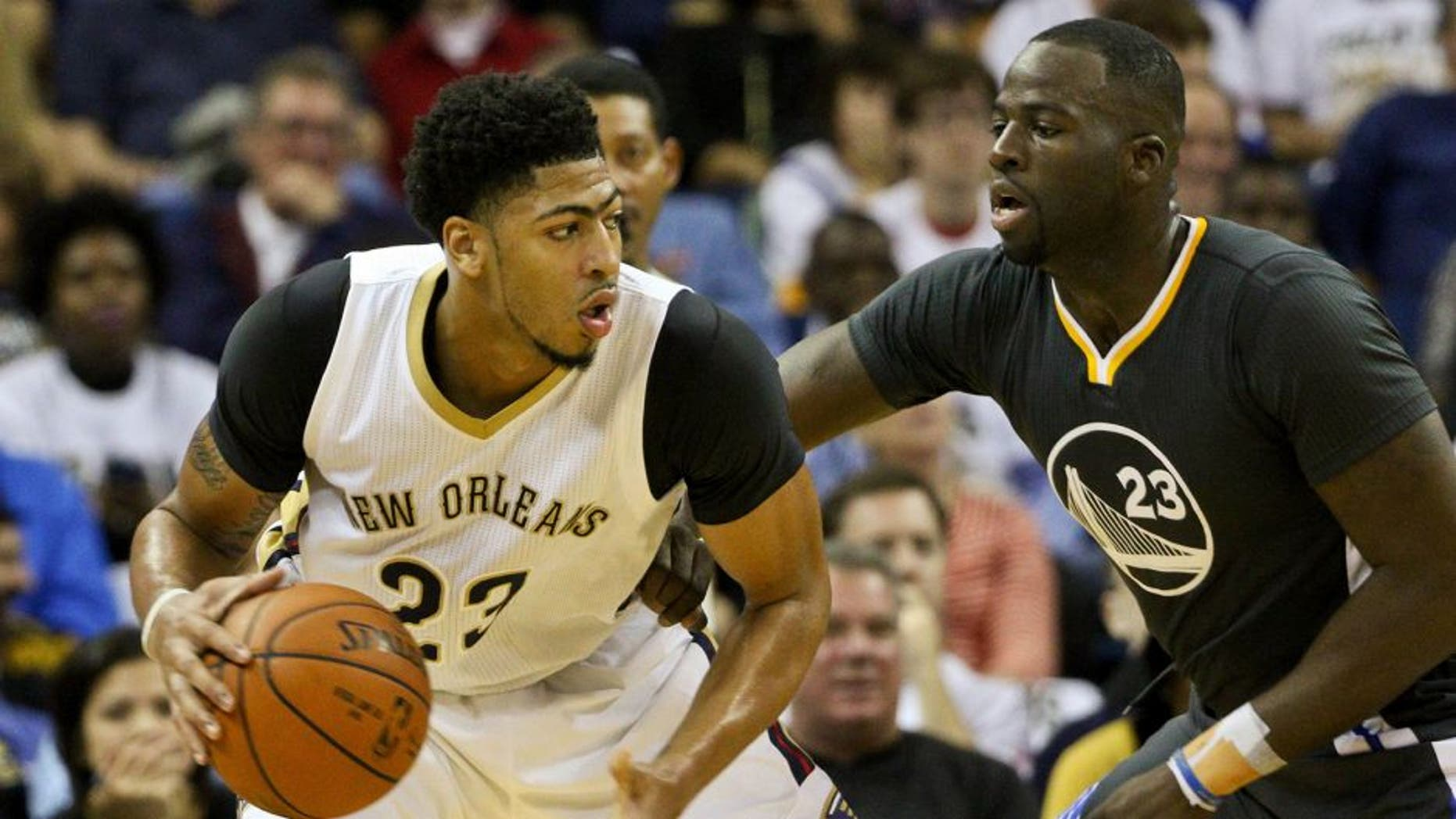 Oct 31, 2015; New Orleans, LA, USA; New Orleans Pelicans forward Anthony Davis (23) is guarded by Golden State Warriors forward Draymond Green (23) during the first half of a game at Smoothie King Center. Mandatory Credit: Derick E. Hingle-USA TODAY Sports