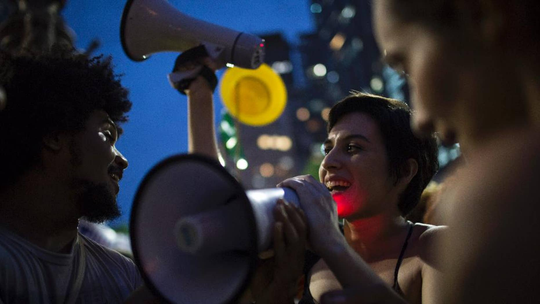 Demonstrators chant slogans during a march in support of Brazil's President Dilma Rousseff and former President Luiz Inacio Lula da Silva in Rio de Janeiro, Brazil, Thursday, March 31, 2016. Rousseff is currently facing impeachment proceedings as her government faces a stalling national economy and multiple corruption scandals. Lula da Silva has been linked to a sprawling corruption scandal involving Brazilian oil giant Petrobras. (AP Photo/Felipe Dana)