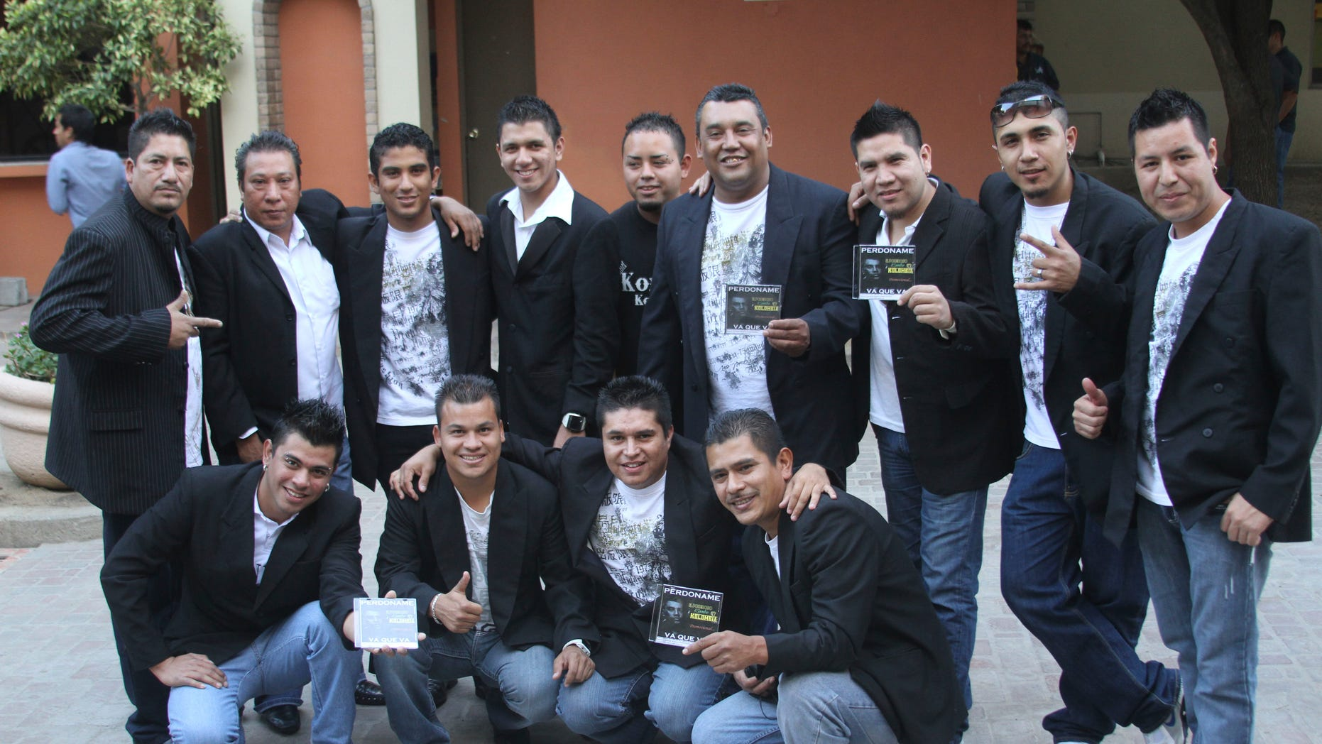 In this Nov. 15, 2011 photo, members of the Colombian style music band Kombo Kolombia pose for the press during a promotional event in Monterrey, Mexico. Sixteen members of the band Kombo Kolombia and four crew members were kidnapped on Friday, Jan. 25, 2013, after playing at a private party held at a ranch called La Carreta, or The Wagon, in the town of Hidalgo north of Monterrey. A member of the band, who managed to escape, led authorities to a well along a dirt road where searchers found several bodies which, authorities said on Monday, Jan. 28, all indicates that they belong to the missing band members. (AP Photo)