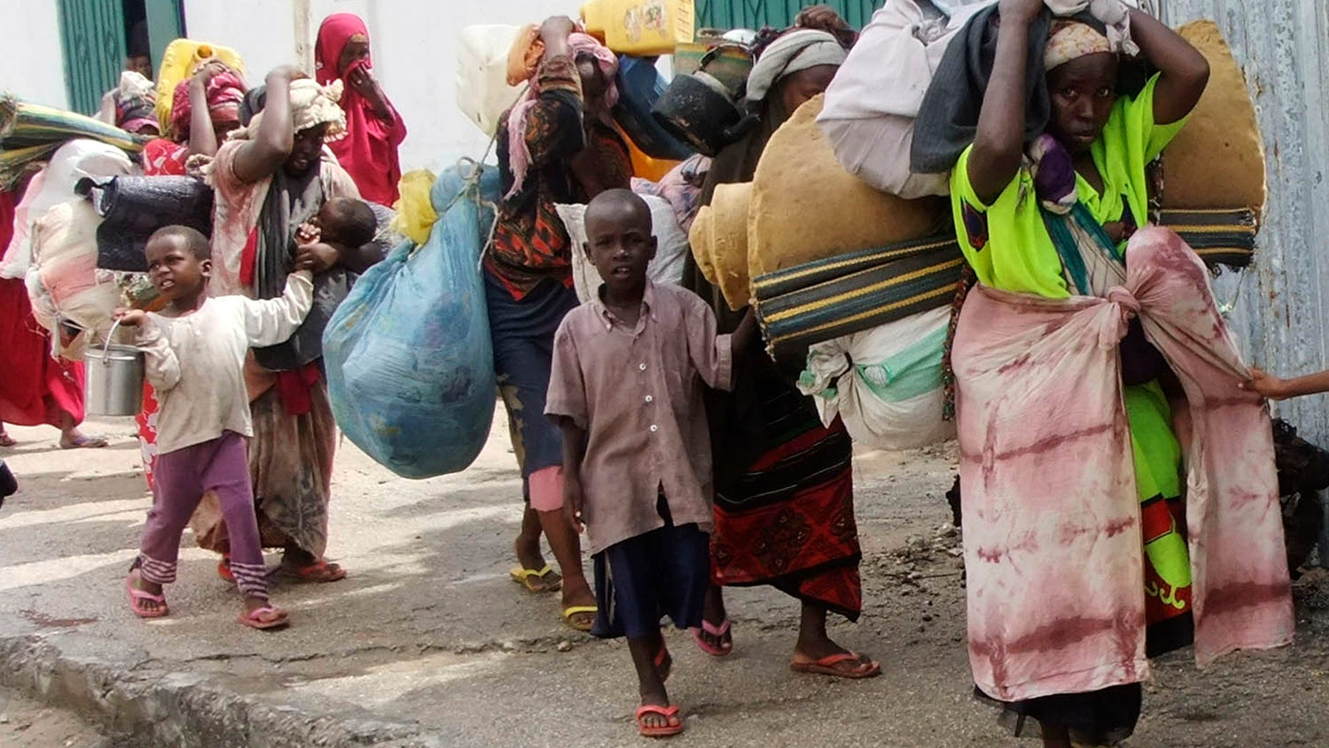Aug. 5, 2011: Somalis carry their belongings from southern Somalia as they arrive in Mogadishu, Somalia