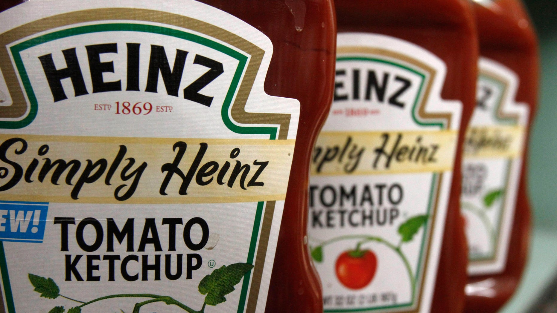 FILE - This Wednesday, March 2, 2011, file photo, shows containers of Heinz ketchup on the shelf of a market, in Barre, Vt. H.J. Heinz Co. is buying Kraft Foods Group Inc., creating what the companies say will be the third-largest food and beverage company in North America, the companies announced Wednesday, March 25, 2015. (AP Photo/Toby Talbot, File)