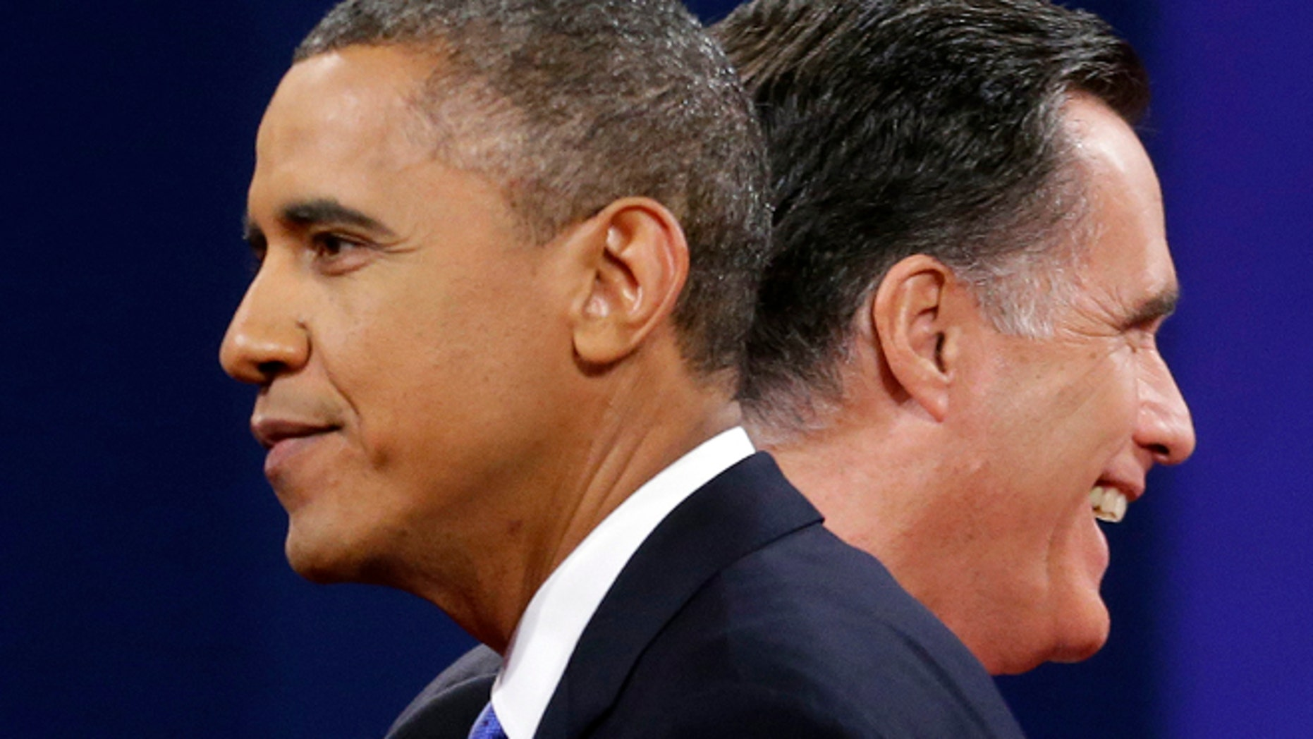 FILE: Oct 16, 2012: Mitt Romney and President Obama walks past each other at the end of their last debate at Lynn University, in Boca Raton, Fla.