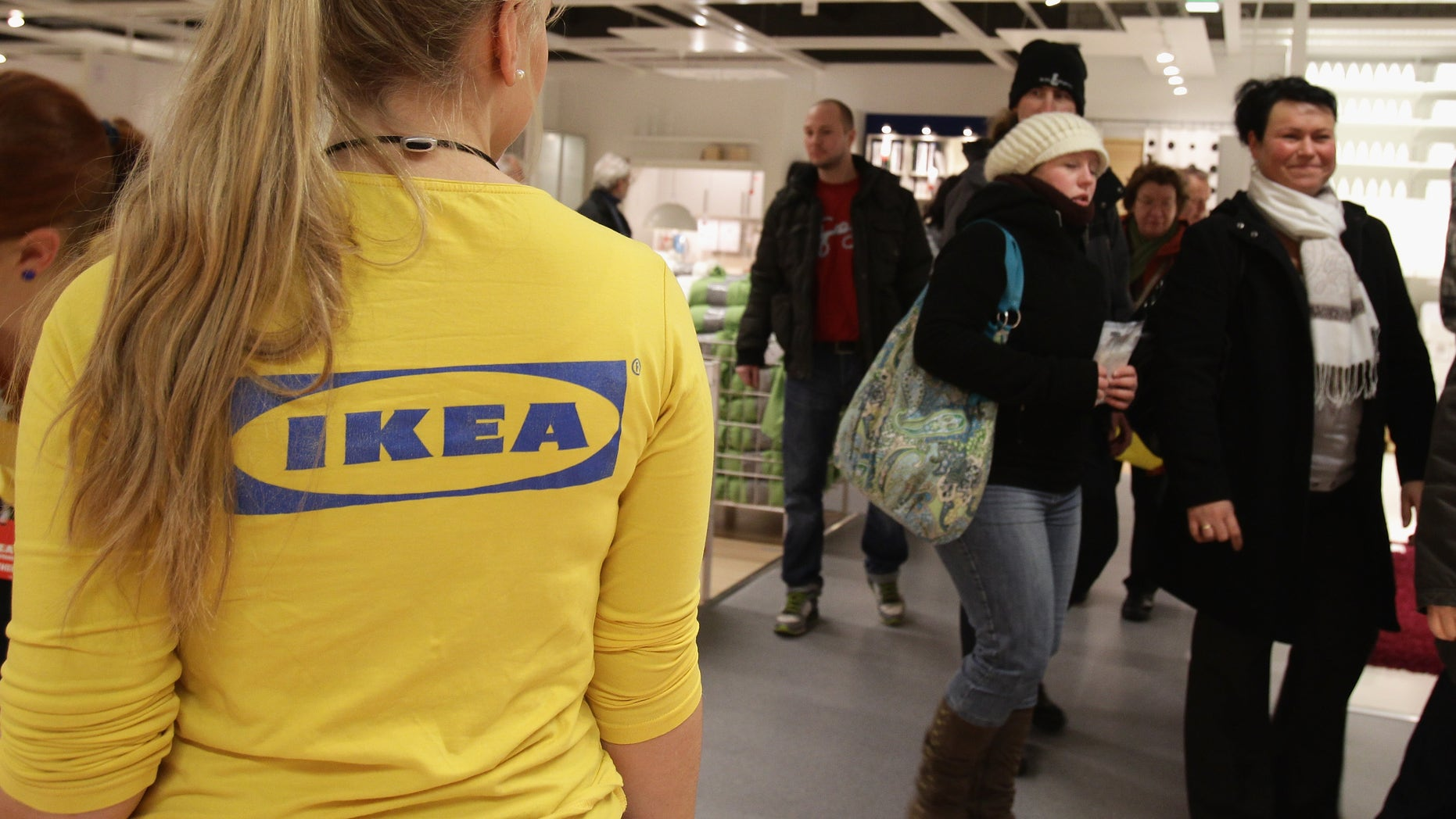 BERLIN, GERMANY - DECEMBER 13:  An Ikea employee watches customers shopping during a store opening at the 4th Ikea chain store in Berlin Lichtenberg on December 13, 2010 in Berlin, Germany. Ikea, a Swedish furniture and household goods company now has 46th chain stores in Germany, including the newly opened one in Berlin Lichtenberg, which is the biggest one in Germany.  (Photo by Andreas Rentz/Getty Images)