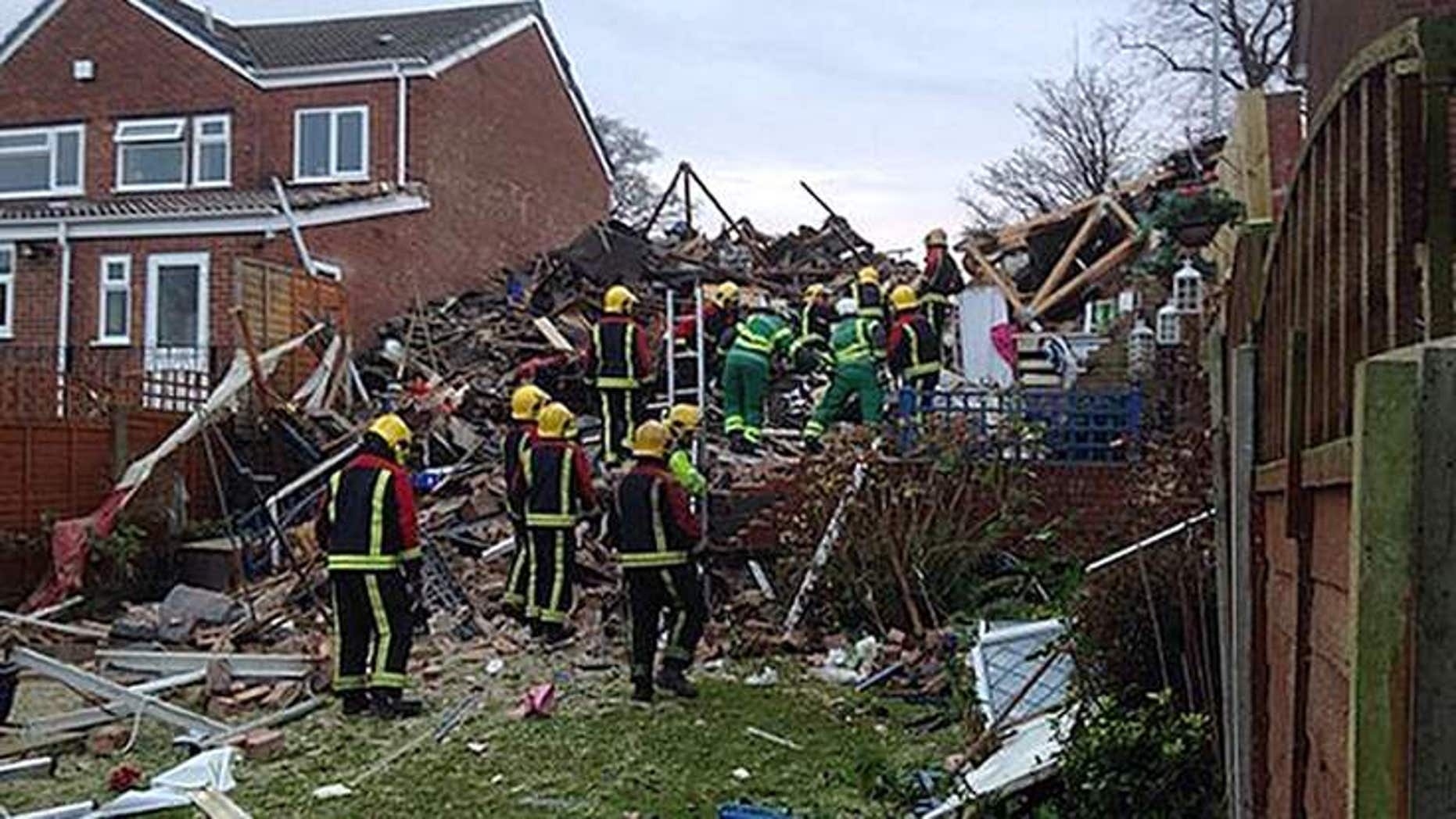 A woman rescued after a suspected gas blast destroyed her home was saved by her washing machine. (Sky News)