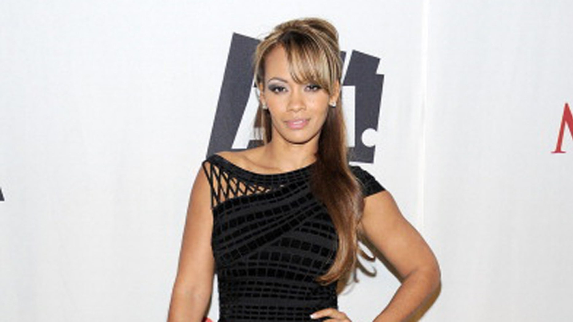 DALLAS, TX - FEBRUARY: Evelyn Lozada poses with AOL at the Maxim Party Powered by Motorola Xoom at Centennial Hall at Fair Park  in Dallas, Texas.
