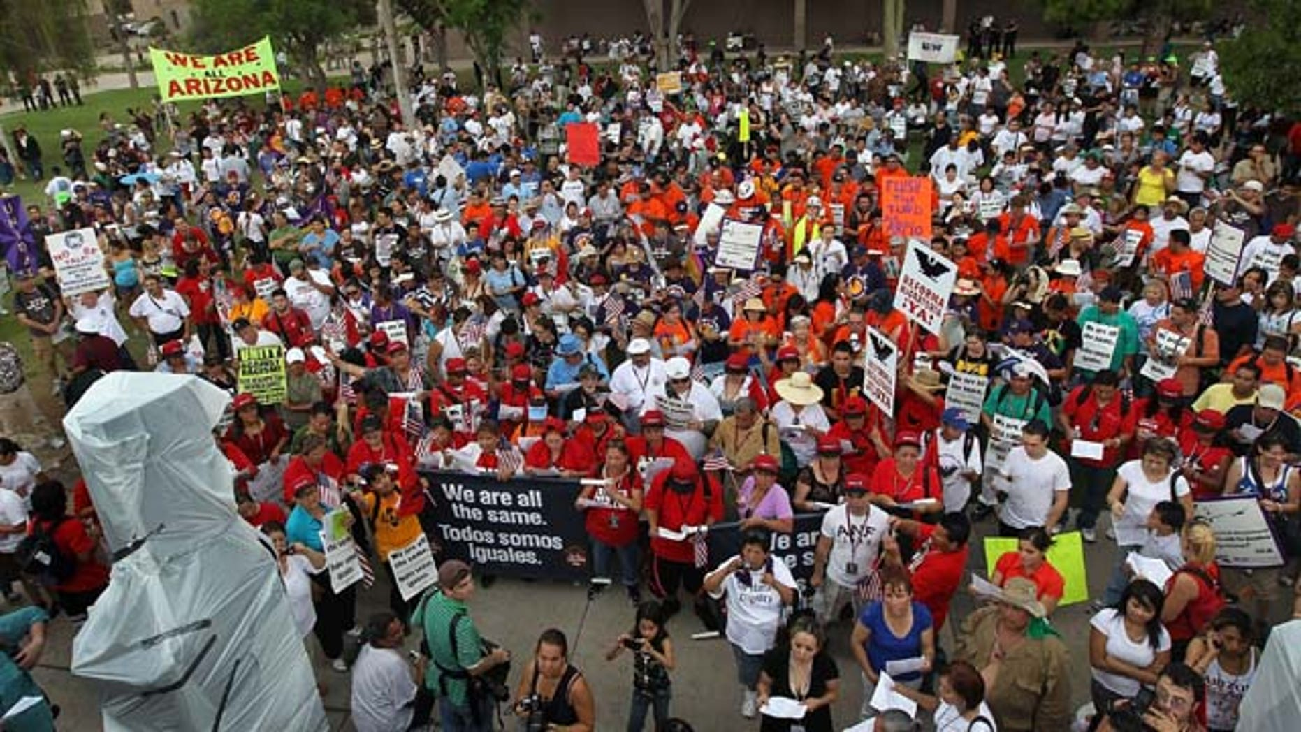 PHOENIX - JULY 29:  Protesters from California join Arizonans at the state capitol building for a demonstration against Arizona's immigration enforcement law SB 1070 on July 29, 2010 in Phoenix, Arizona. The Californians came in solidarity with Arizonan opponents of the law, which many people saw as biased against Latinos. U.S. District Court Judge Susan Bolton Wednesday suspended several controversial provisions of the law, which went into effect today.  (Photo by John Moore/Getty Images)
