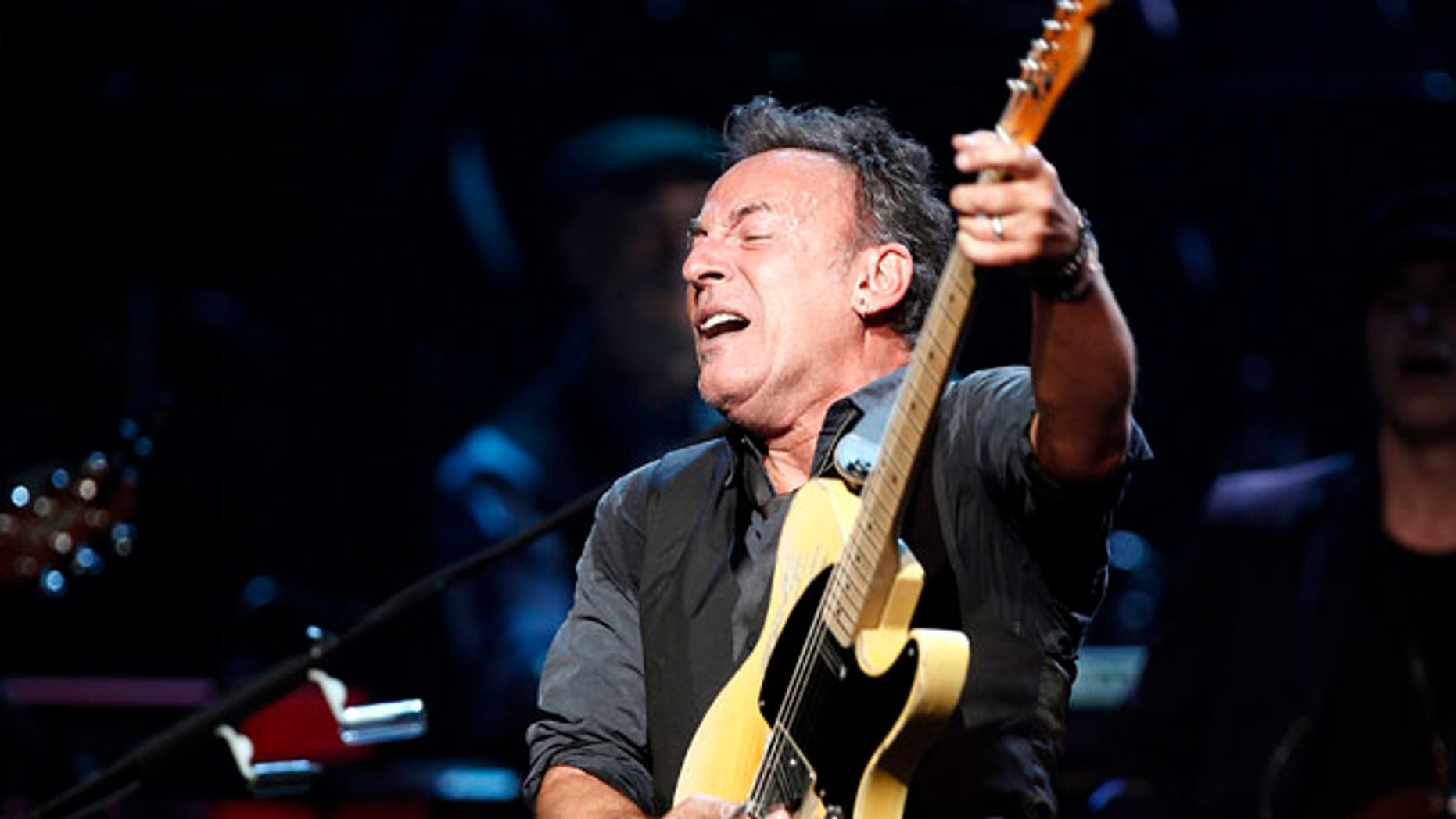 Bruce Springsteen and the E Street Band perform onstage during SiriusXM's 10th anniversary celebration at the Apollo Theater in Harlem, New York March 9, 2012.      REUTERS/Carlo Allegri (UNITED STATES - Tags: ENTERTAINMENT)