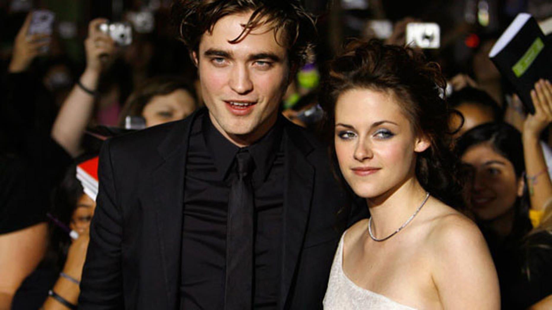 Robert Pattinson is 'drunk dialing' Kristen Stewart ...