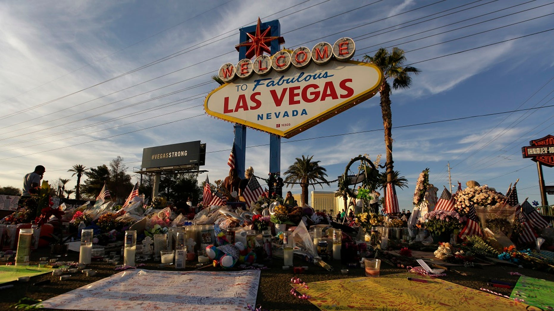 People visit a makeshift memorial for victims of the Oct. 1 mass shooting in Las Vegas, Oct. 16, 2017.