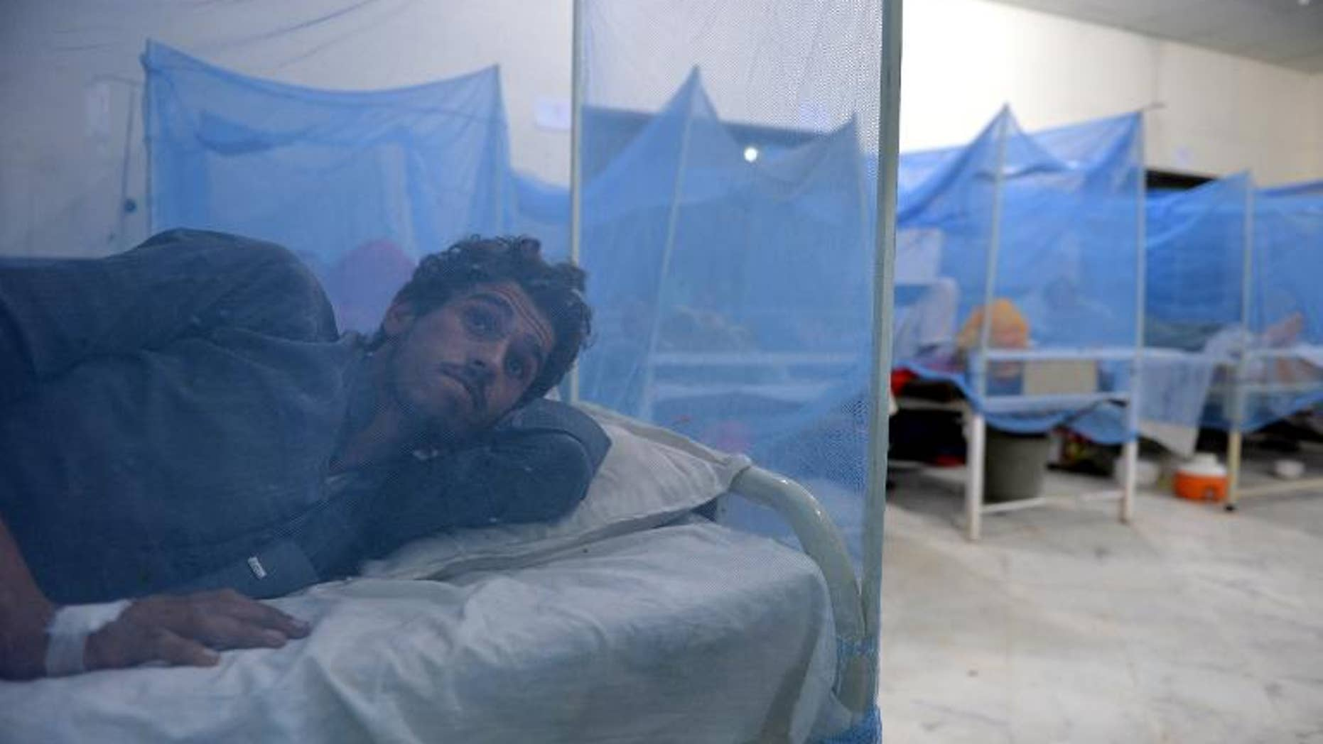 Dengue fever patients at a hospital in Mingora, the main city in Pakistan's Swat Valley, on September 23, 2013