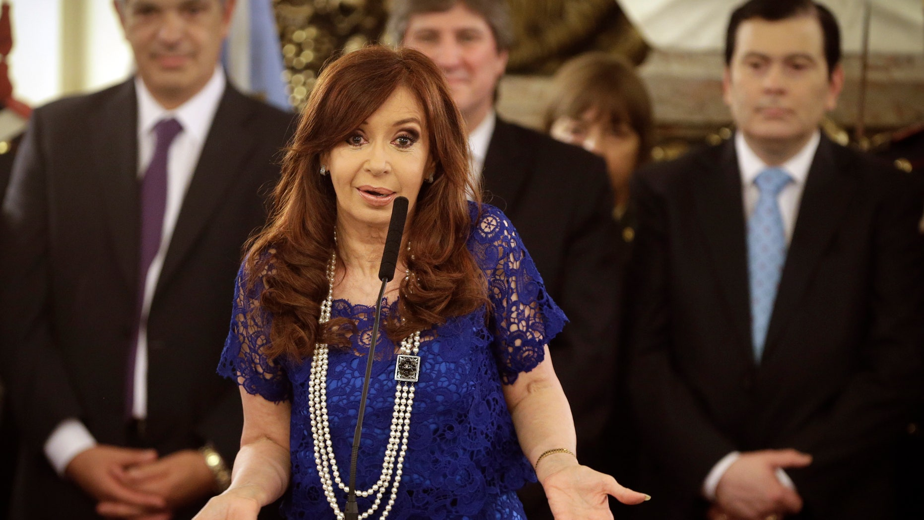 FILE - In this Feb. 26, 2015, file photo, Argentine President Cristina Fernandez speaks after the swearing-in ceremony for several new cabinet members at Casa Rosada presidential palace in Buenos Aires, Argentina. On Thursday, March 26, 2015, a federal appeals court in Argentina has thrown out a case that accused President Cristina Fernandez of orchestrating a deal to cover up the alleged role of Iranian officials in the 1994 bombing of a Jewish community center. (AP Photo/Victor R. Caivano, File)