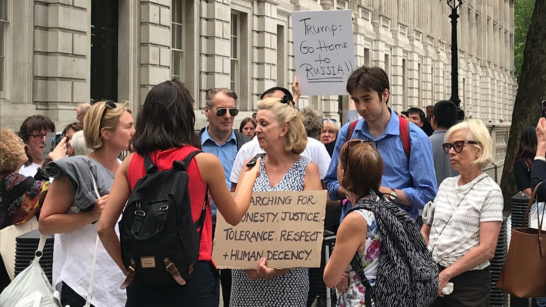 Protesters gather outside 10 Downing Street