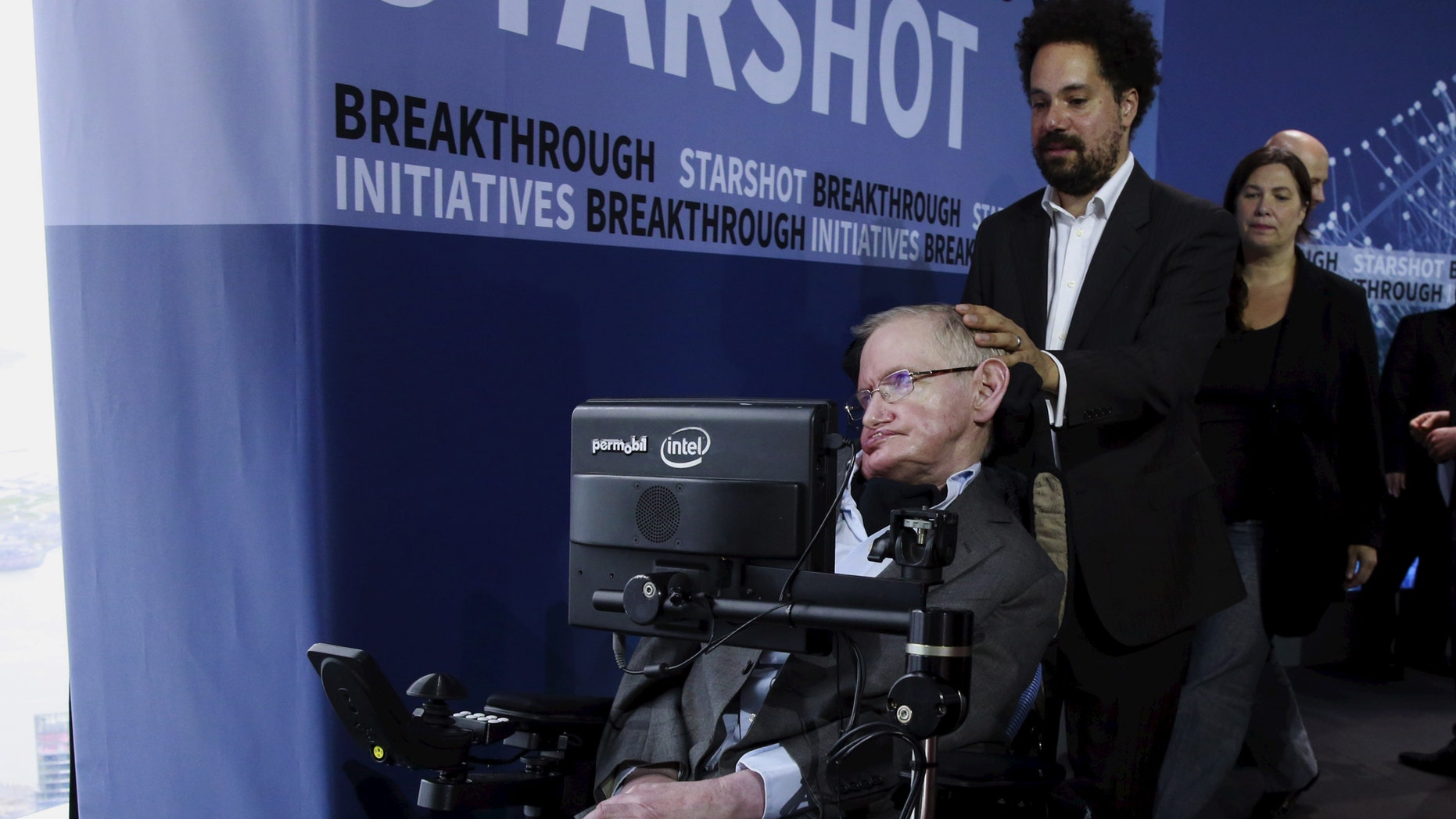 File photo: Physicist Stephen Hawking exits the stage during an announcement of the Breakthrough Starshot initiative with investor Yuri Milner in New York April 12, 2016. (REUTERS/Lucas Jackson)