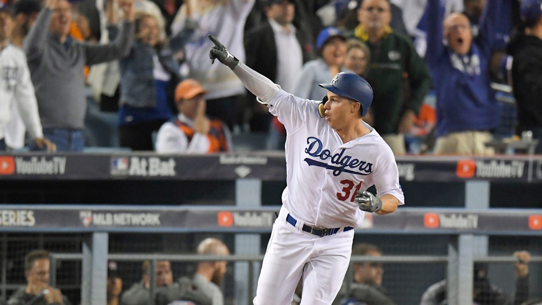Los Angeles Dodgers' Joc Pederson celebrates his home run off against the Houston Astros during the seventh inning of Game 6 of baseball's World Series Tuesday, Oct. 31, 2017, in Los Angeles