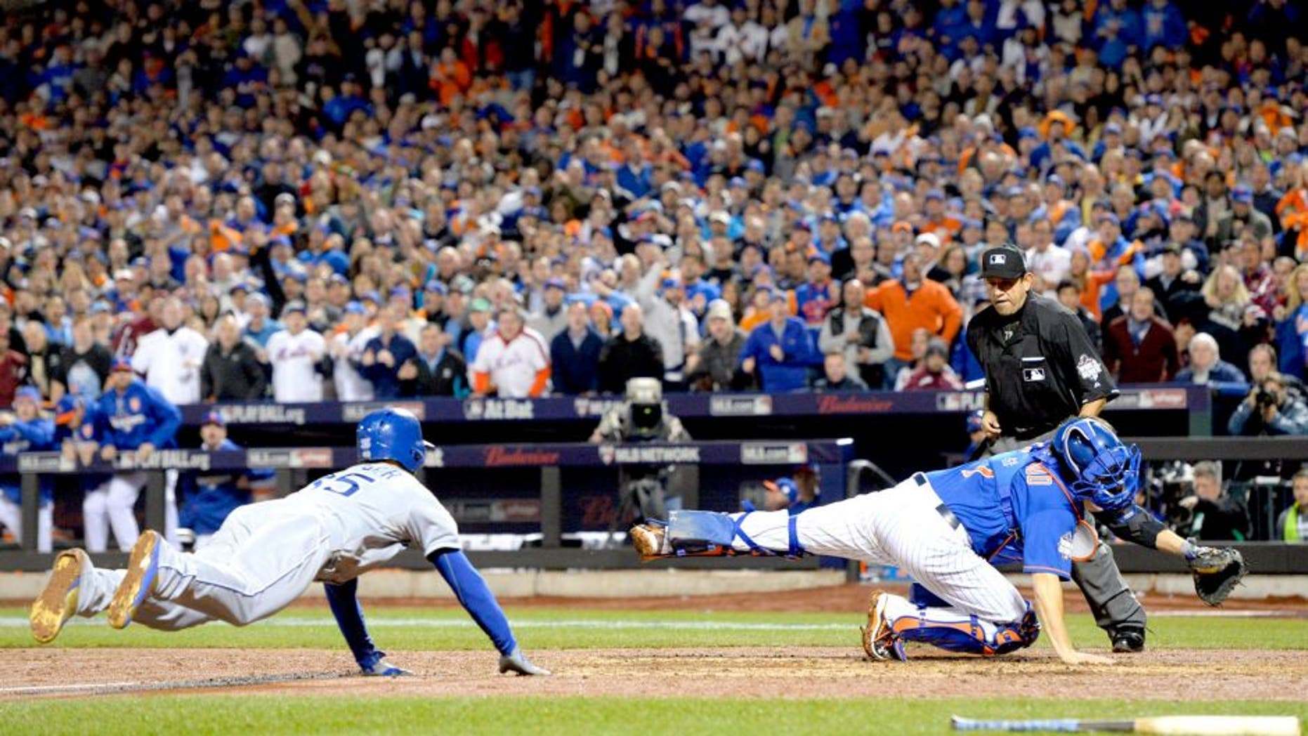 Nov 1, 2015; New York City, NY, USA; Kansas City Royals first baseman Eric Hosmer (35) scores the tying run past New York Mets catcher Travis d'Arnaud (7) in the 9th inning in game five of the World Series at Citi Field. Mandatory Credit: Robert Deutsch-USA TODAY Sports