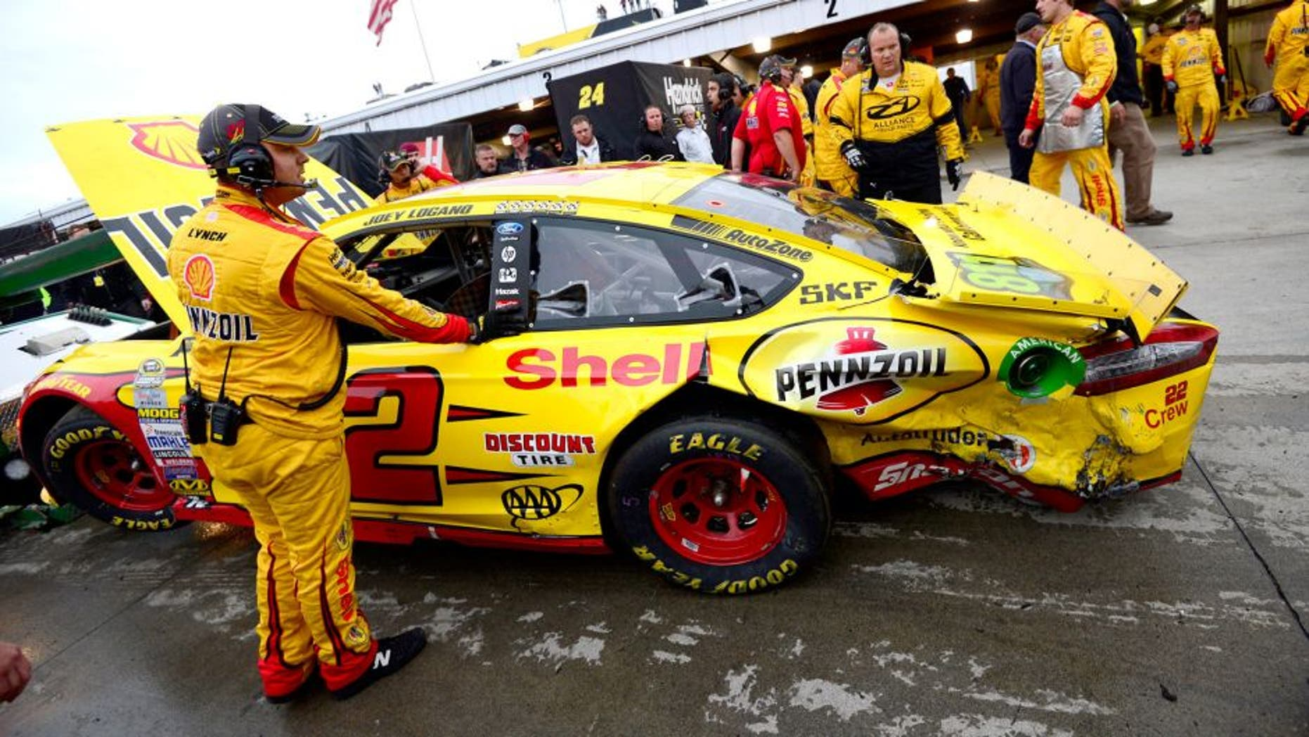 MARTINSVILLE, VA - NOVEMBER 01: The #22 Shell Pennzoil Ford of Joey Logano is towed into the garage area after an incident with Matt Kenseth, driver of the #20 Dollar General Toyota, during the NASCAR Sprint Cup Series Goody's Headache Relief Shot 500 at Martinsville Speedway on November 1, 2015 in Martinsville, Virginia. (Photo by Robert Laberge/Getty Images)