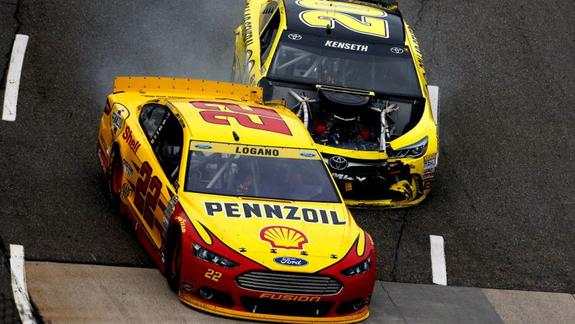 MARTINSVILLE, VA - NOVEMBER 01: Matt Kenseth, driver of the #20 Dollar General Toyota, crashes hits Joey Logano, driver of the #22 Shell Pennzoil Ford, during the NASCAR Sprint Cup Series Goody's Headache Relief Shot 500 at Martinsville Speedway on November 1, 2015 in Martinsville, Virginia. (Photo by Jeff Zelevansky/Getty Images)