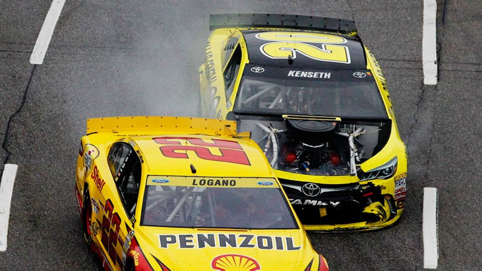 MARTINSVILLE, VA - NOVEMBER 01: Matt Kenseth, driver of the #20 Dollar General Toyota, makes contact with Joey Logano, driver of the #22 Shell Pennzoil Ford, during the NASCAR Sprint Cup Series Goody's Headache Relief Shot 500 at Martinsville Speedway on November 1, 2015 in Martinsville, Virginia. (Photo by Brian Lawdermilk/NASCAR via Getty Images)