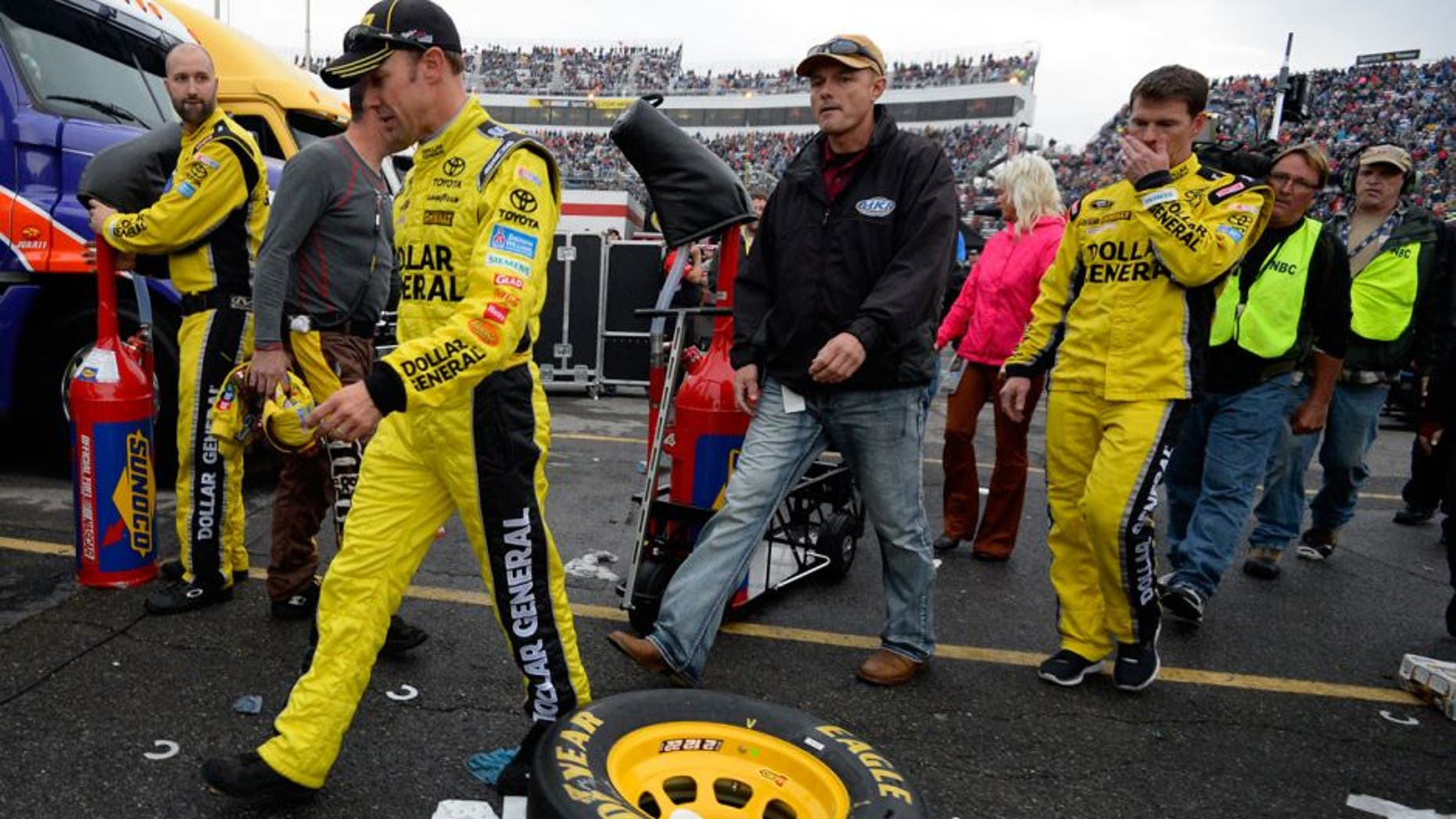 MARTINSVILLE, VA - NOVEMBER 01: Matt Kenseth, driver of the #20 Dollar General Toyota, walks through the garage area after an on-track incident with Joey Logano during the NASCAR Sprint Cup Series Goody's Headache Relief Shot 500 at Martinsville Speedway on November 1, 2015 in Martinsville, Virginia. (Photo by Robert Laberge/Getty Images)