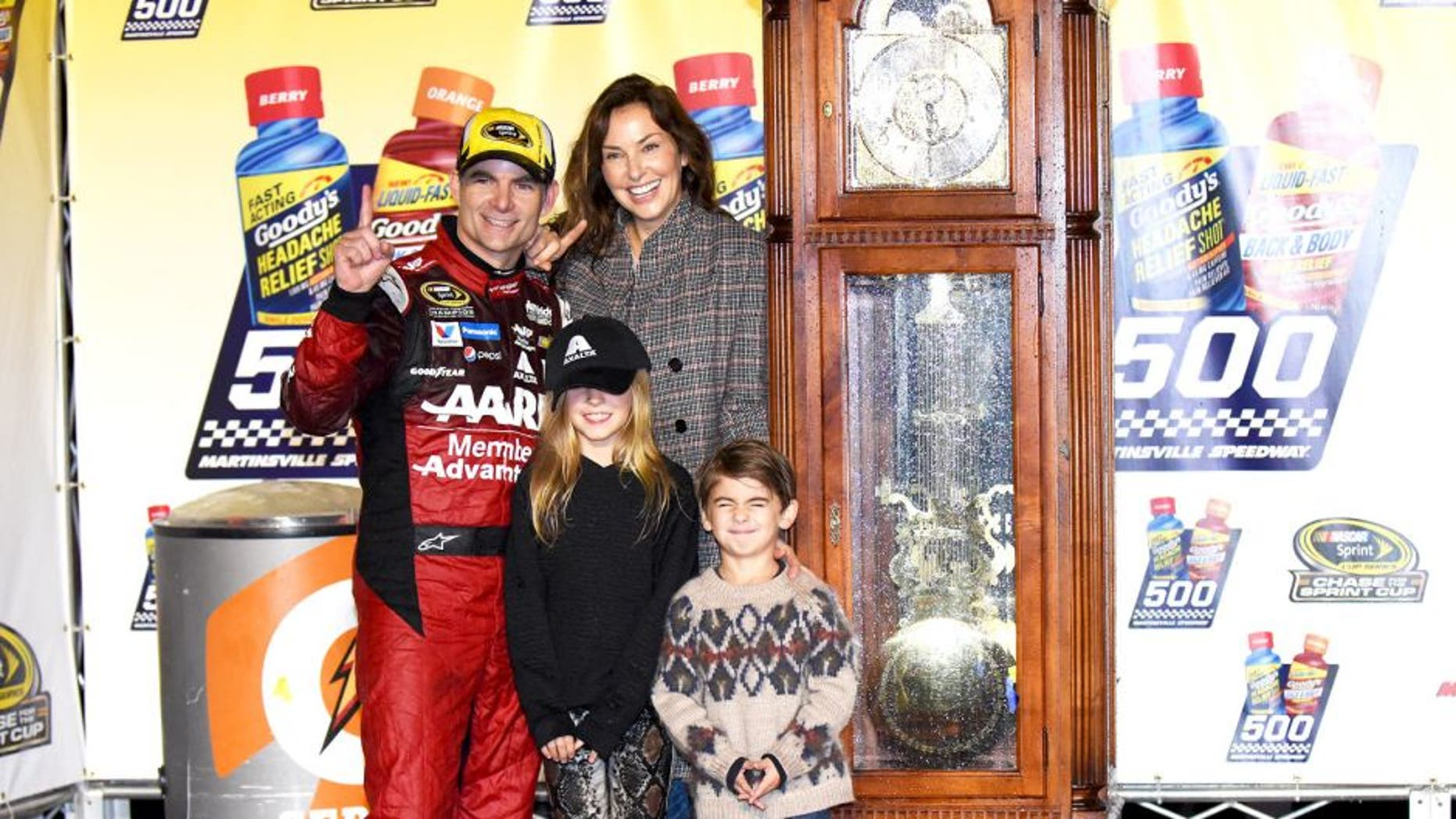 MARTINSVILLE, VA - NOVEMBER 01: Jeff Gordon, driver of the #24 AARP Member Advantages Chevrolet, celebrates in Victory Lane with his wife Ingrid Vandebosch, daughter Ella and son Leo after winning the NASCAR Sprint Cup Series Goody's Headache Relief Shot 500 at Martinsville Speedway on November 1, 2015 in Martinsville, Virginia. (Photo by Jonathan Moore/Getty Images)
