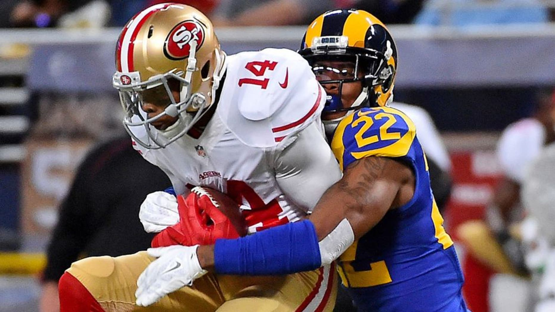 Nov 1, 2015; St. Louis, MO, USA; St. Louis Rams cornerback Trumaine Johnson (22) tackles San Francisco 49ers wide receiver Jerome Simpson (14) during the second half at the Edward Jones Dome. Mandatory Credit: Jasen Vinlove-USA TODAY Sports