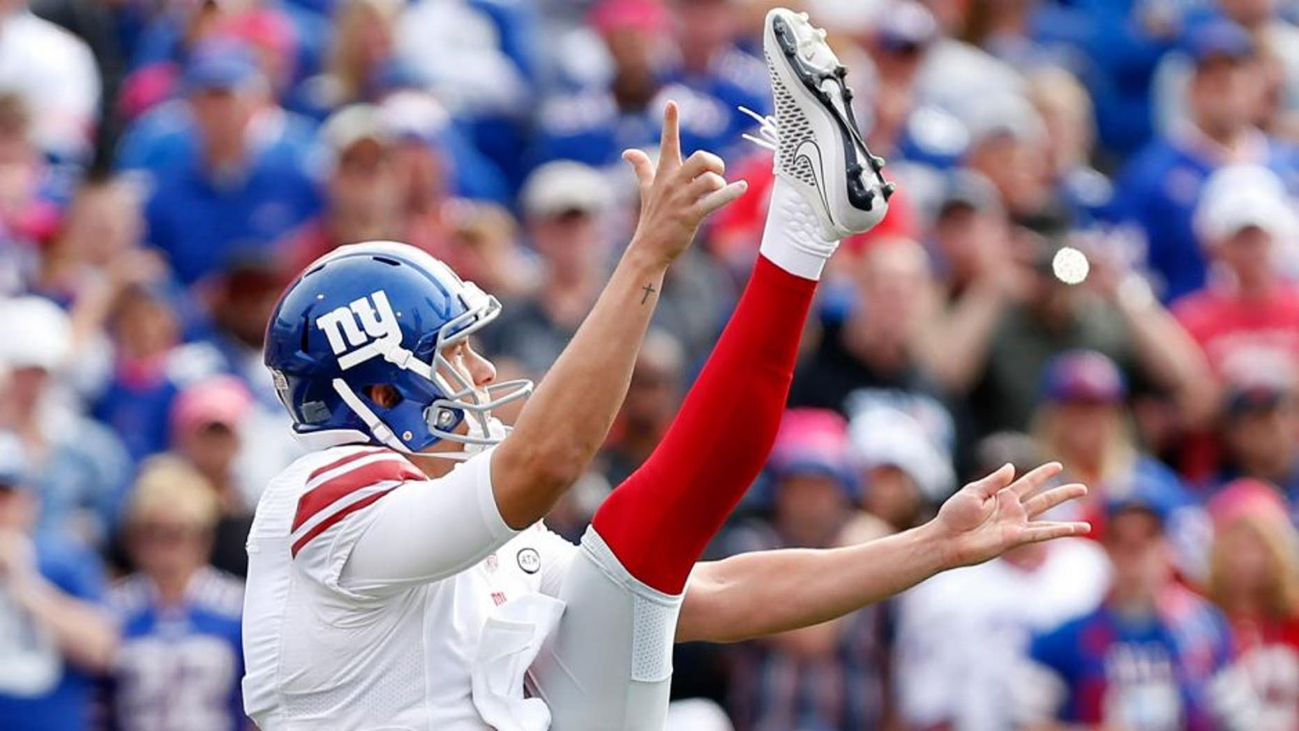 Oct 4, 2015; Orchard Park, NY, USA; New York Giants punter Brad Wing (9) during the game against the Buffalo Bills at Ralph Wilson Stadium. Mandatory Credit: Kevin Hoffman-USA TODAY Sports