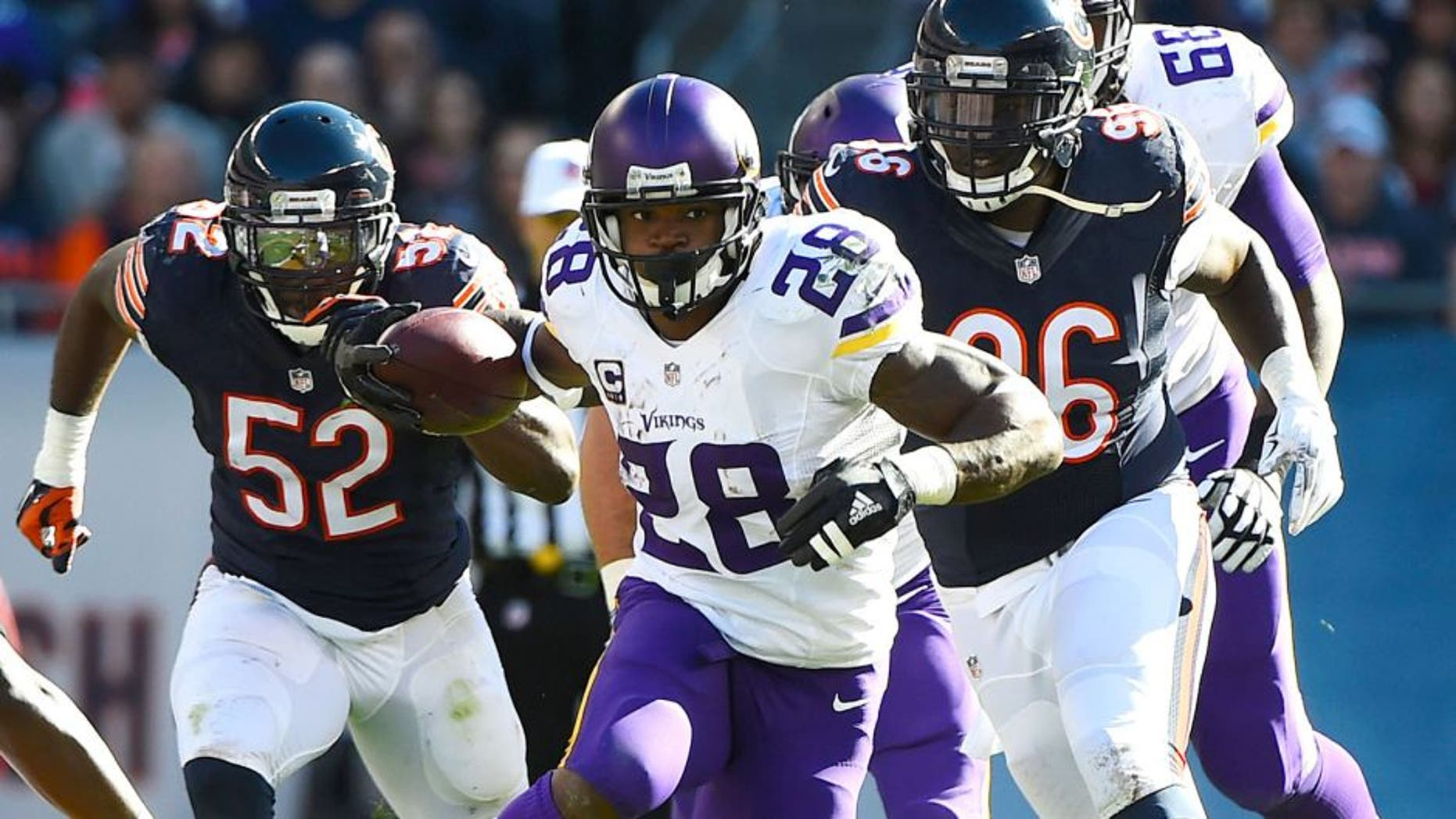 Nov 1, 2015; Chicago, IL, USA; Minnesota Vikings running back Adrian Peterson (28) carries the ball against the Chicago Bears during the first half at Soldier Field. Mandatory Credit: Mike DiNovo-USA TODAY Sports