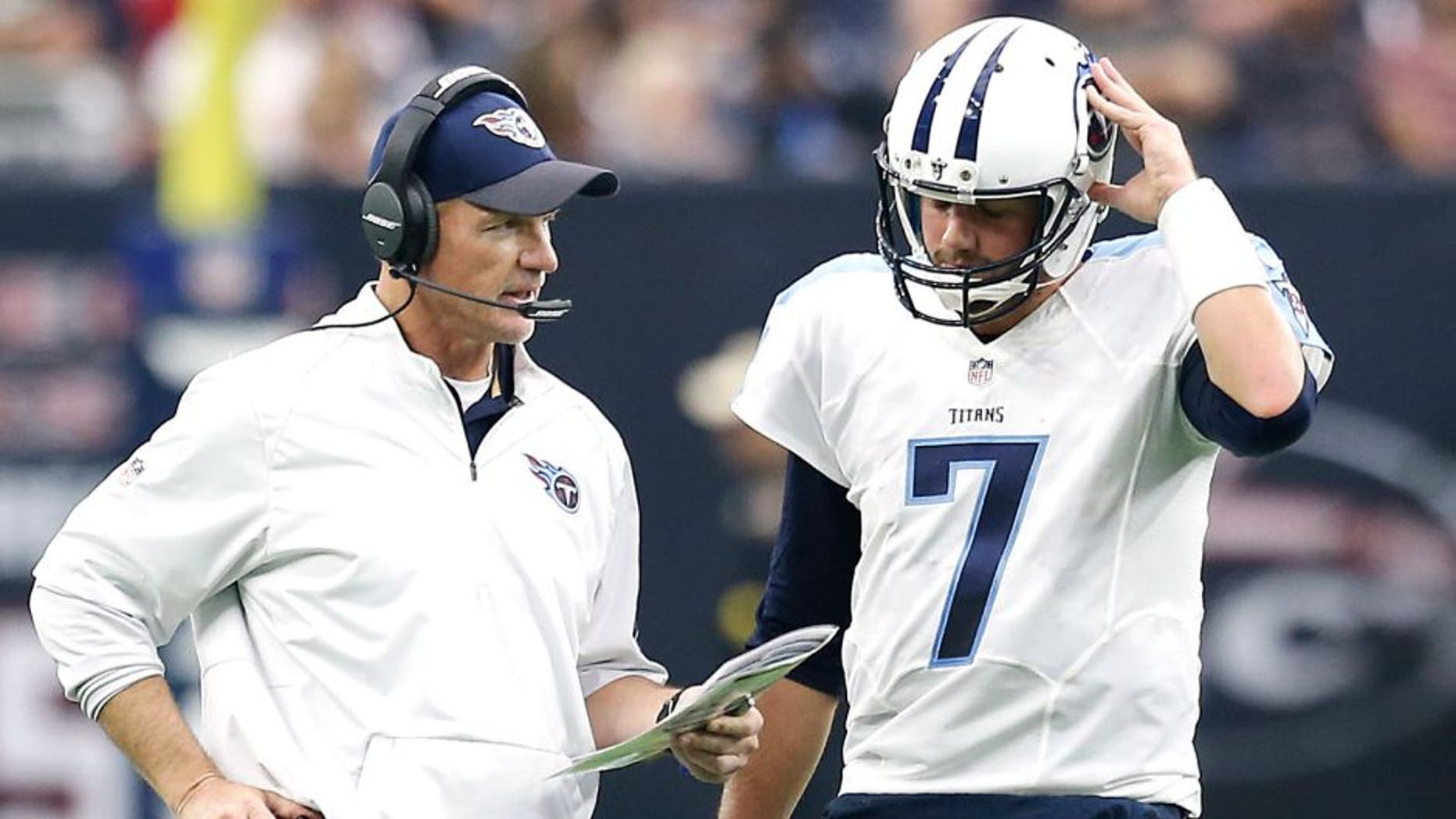HOUSTON, TX - NOVEMBER 01: Head coach Ken Whisenhunt talks with Zach Mettenberger #7 of the Tennessee Titans during a timeout against the Houston Texans in the second quarter on November 1, 2015 at NRG Stadium in Houston, Texas. (Photo by Thomas B. Shea/Getty Images)