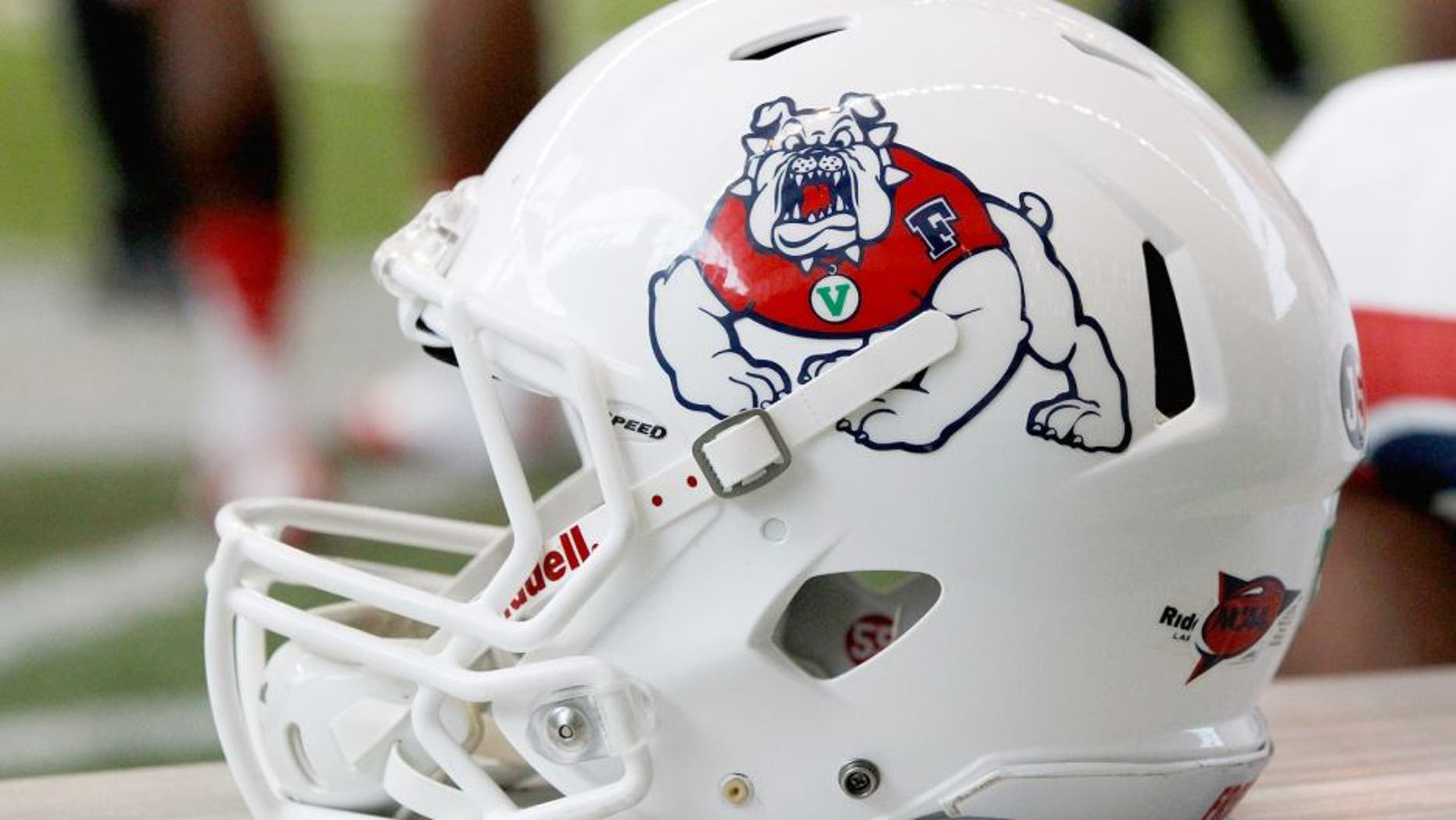 MOSCOW, ID - OCTOBER 05: A Fresno State Bulldogs football helmet sits on the sideline during the game between the Fresno State Bulldogs and the Idaho Vandals on October 5, 2013 at the Kibbie Dome in Moscow, Idaho. (Photo by William Mancebo/Getty Images)