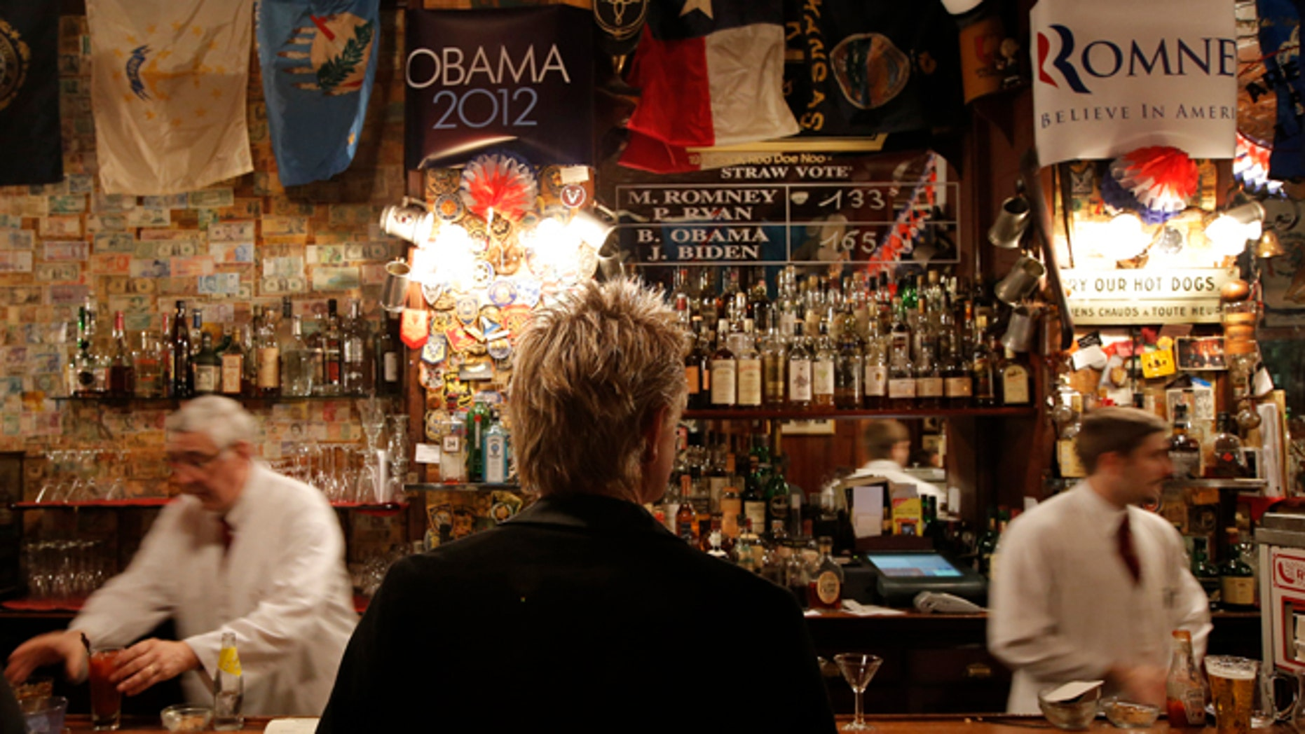Oct. 31, 2012: The temporary results of a U.S. presidential election straw vote is displayed on a board at Harry's Bar in Paris.