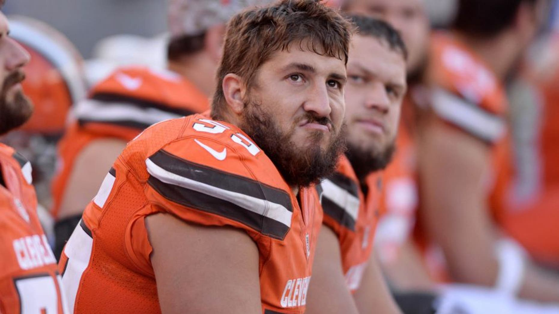 Nov 1, 2015; Cleveland, OH, USA; Cleveland Browns center Alex Mack (55) and guard Joel Bitonio (75) sit on the bench during the fourth quarter against the Arizona Cardinals at FirstEnergy Stadium. The Cardinals won 34-20. Mandatory Credit: Ken Blaze-USA TODAY Sports