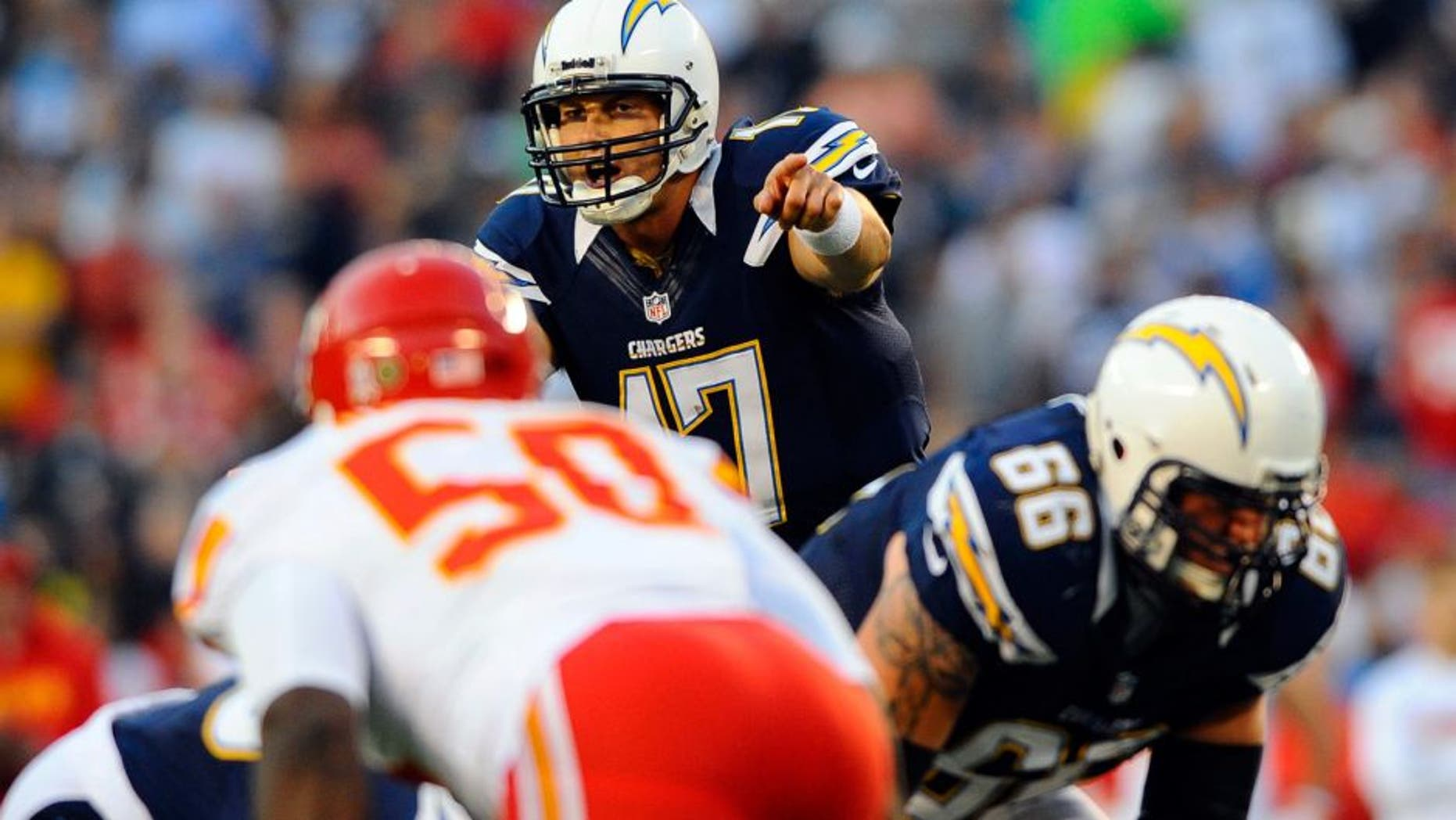 November 1, 2012; San Diego, CA, USA; San Diego Chargers quarterback Philip Rivers (17) calls plays at the line during the first quarter against the Kansas City Chiefs at Qualcomm Stadium. Mandatory Credit: Christopher Hanewinckel-USA TODAY Sports