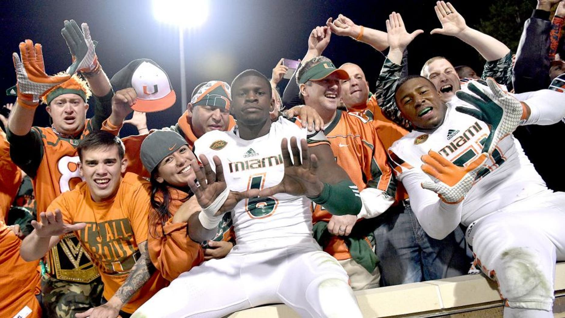 DURHAM, NC - OCTOBER 31: Miami Hurricanes players and fans celebrate after a win against the Duke Blue Devils at Wallace Wade Stadium on October 31, 2015 in Durham, North Carolina. Miami won 30-27 on a last-second touchdown. (Photo by Grant Halverson/Getty Images)